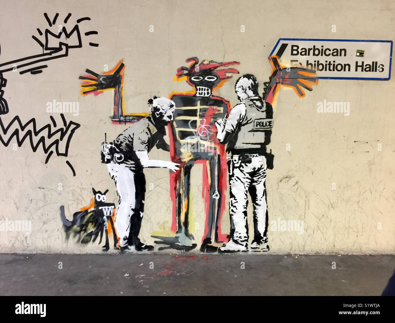 Street art by Bansky, homage to the Jean-Michel Basquiat exhibit at the Barbican Center, London, United Kingdom. Stock Photo
