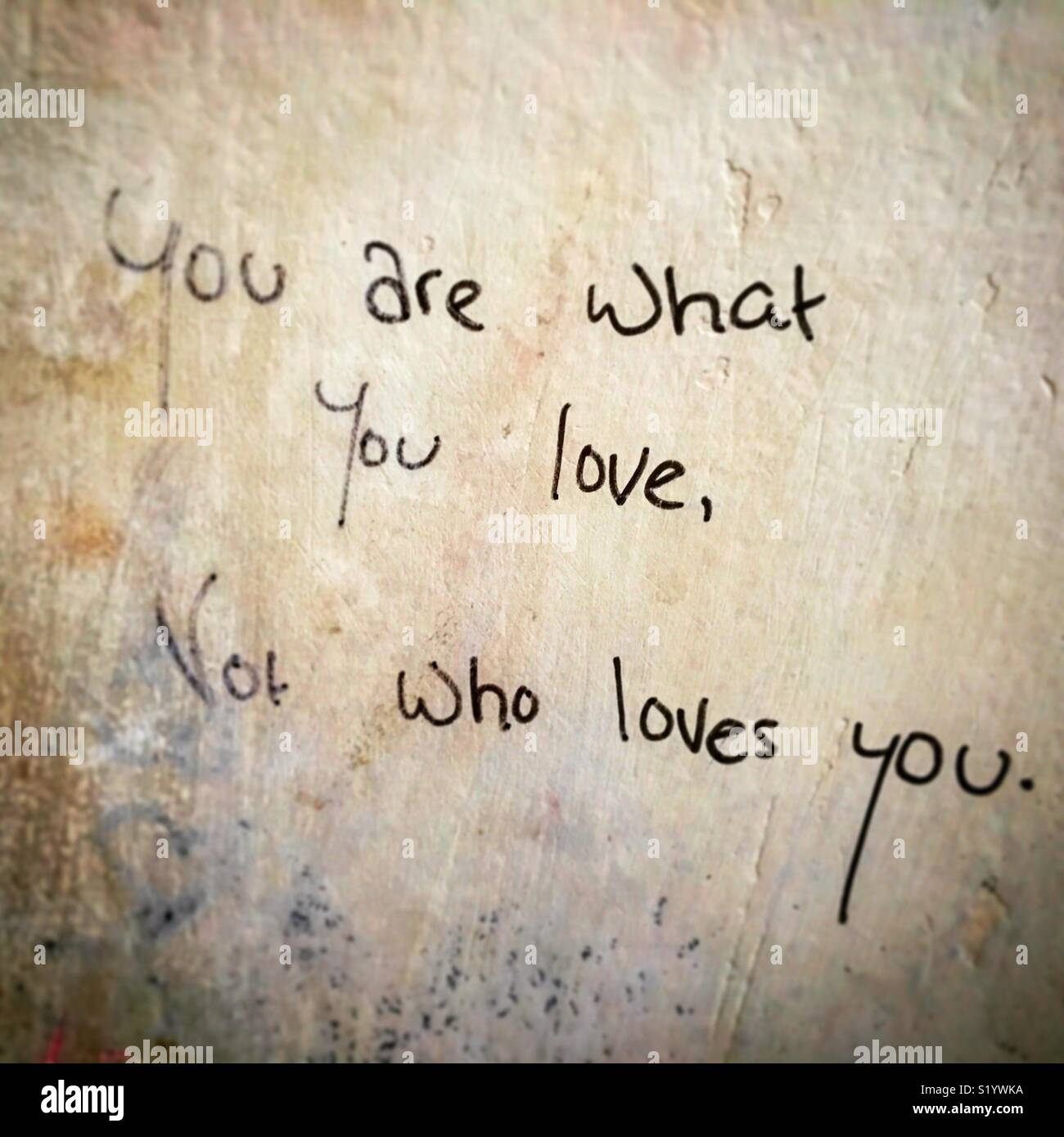 Quotes On A Public Wall About Love And Self Awareness Stock Photo