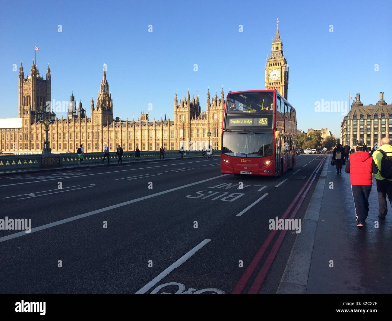 Houses of Parliament with London red bus Stock Photo