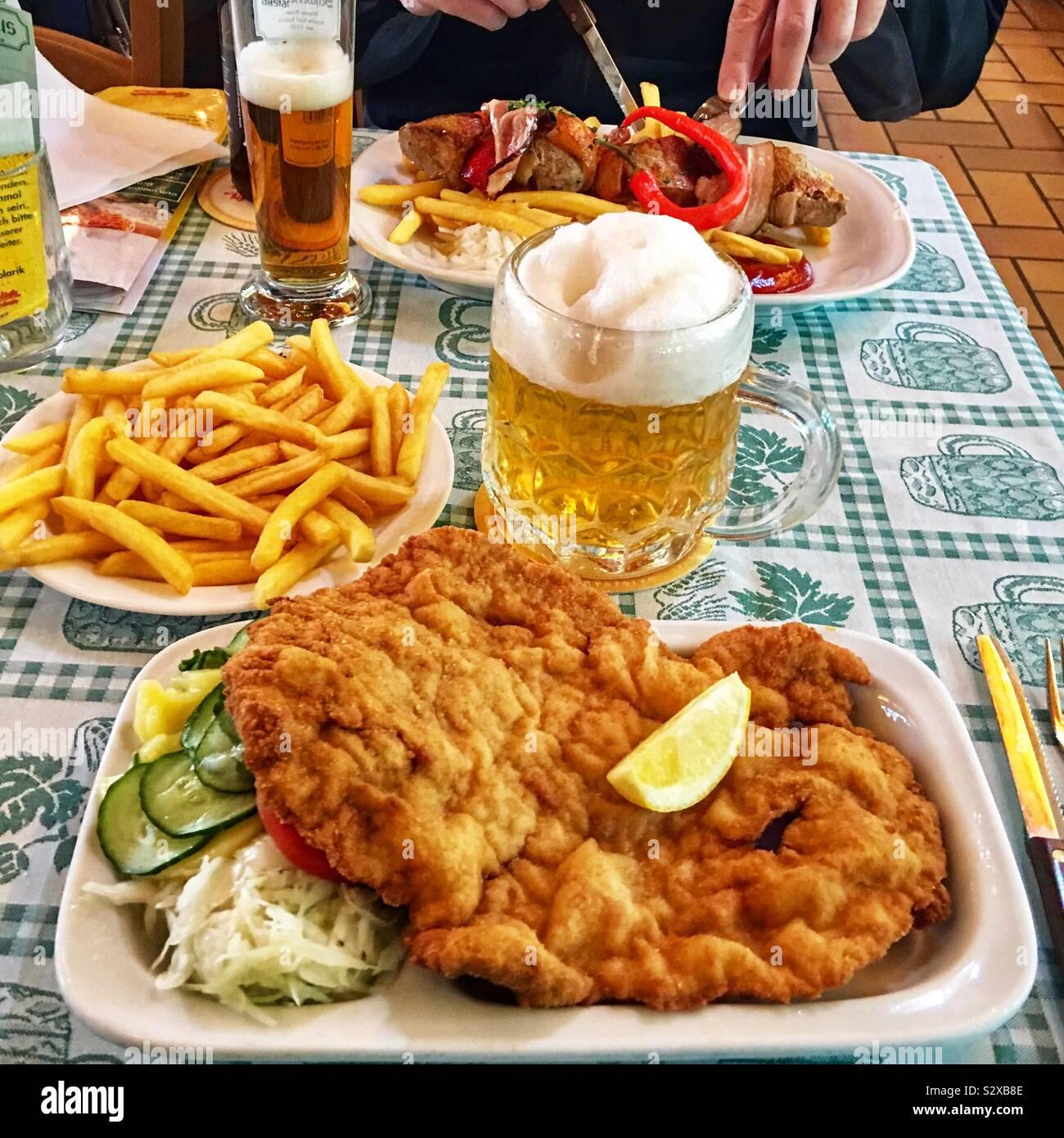 wiener-schnitzel-with-sauerkraut-cucumbe