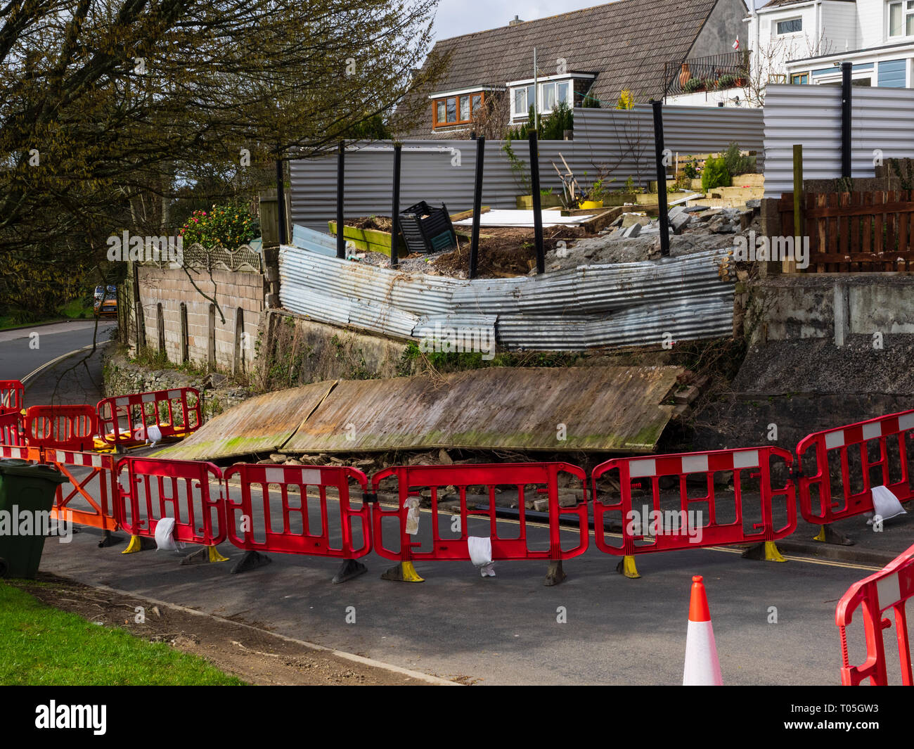 wall-collapse-and-road-closure-following-march-2019-storm-gareth-in-a-plymouth-street-T05GW3.jpg