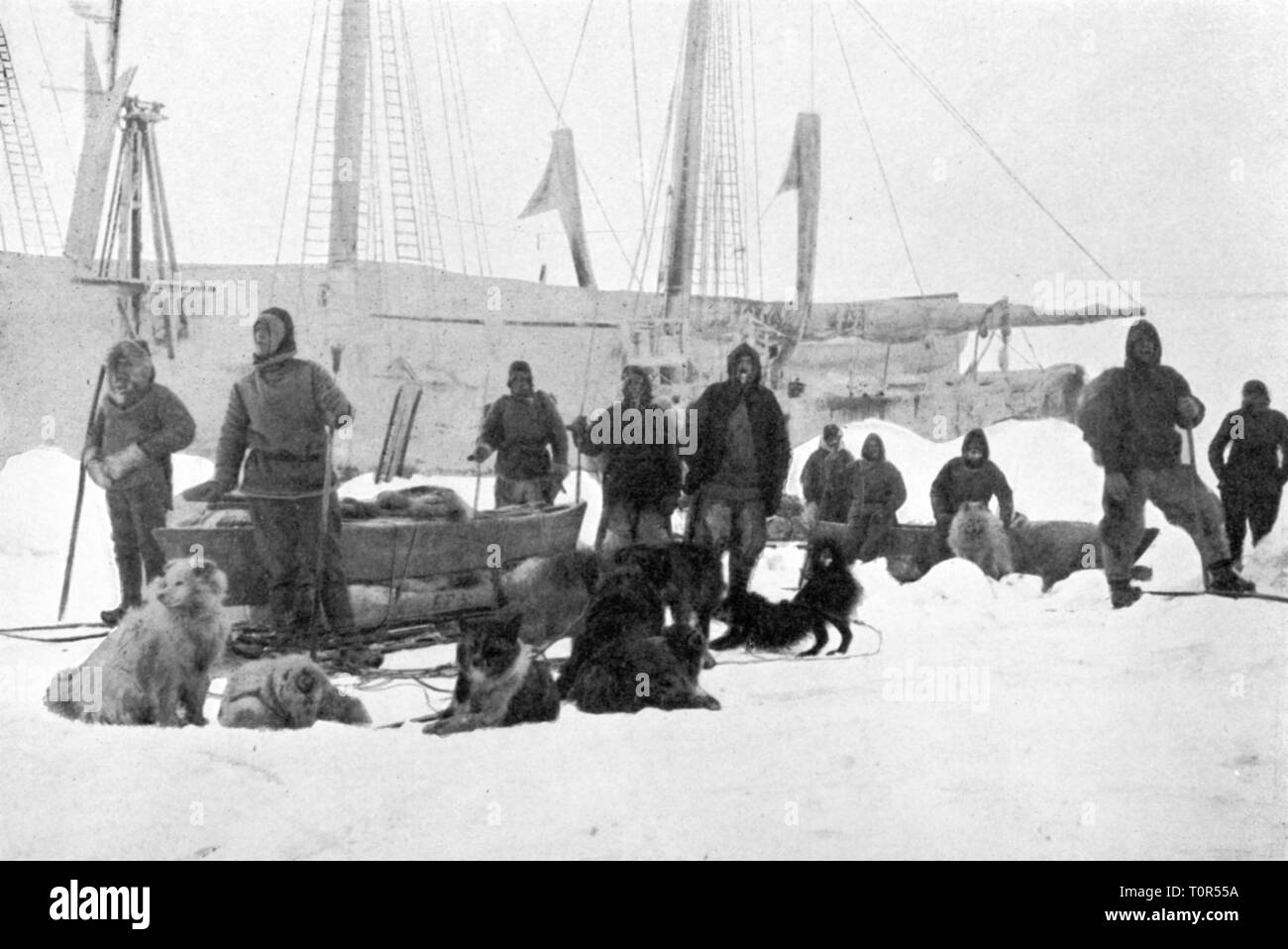"""expedition, polar expedition, Fram expedition 1893 - 1896, Fridtjof Nansen and Fredrik Hjalmar Johansen departing towards North Pole, 14.3.1895, from: Fridtjof Nansen, """"In Nacht und Eis"""", volume II, Leipzig, 1897, 19th century, expedition report, report, reports, travel, travels, research, discovery, discoveries, Arctic, Arctic Ocean, Fram, North Polar Sea, North Pole, Arctic region, North Pole territory, participant, participants, members, member, crew, crews, half length, standing, dog sled, dog sleds, sleigh, animal, animals, dog, dogs, resear, Additional-Rights-Clearance-Info-Not-Available Stock Photo"""