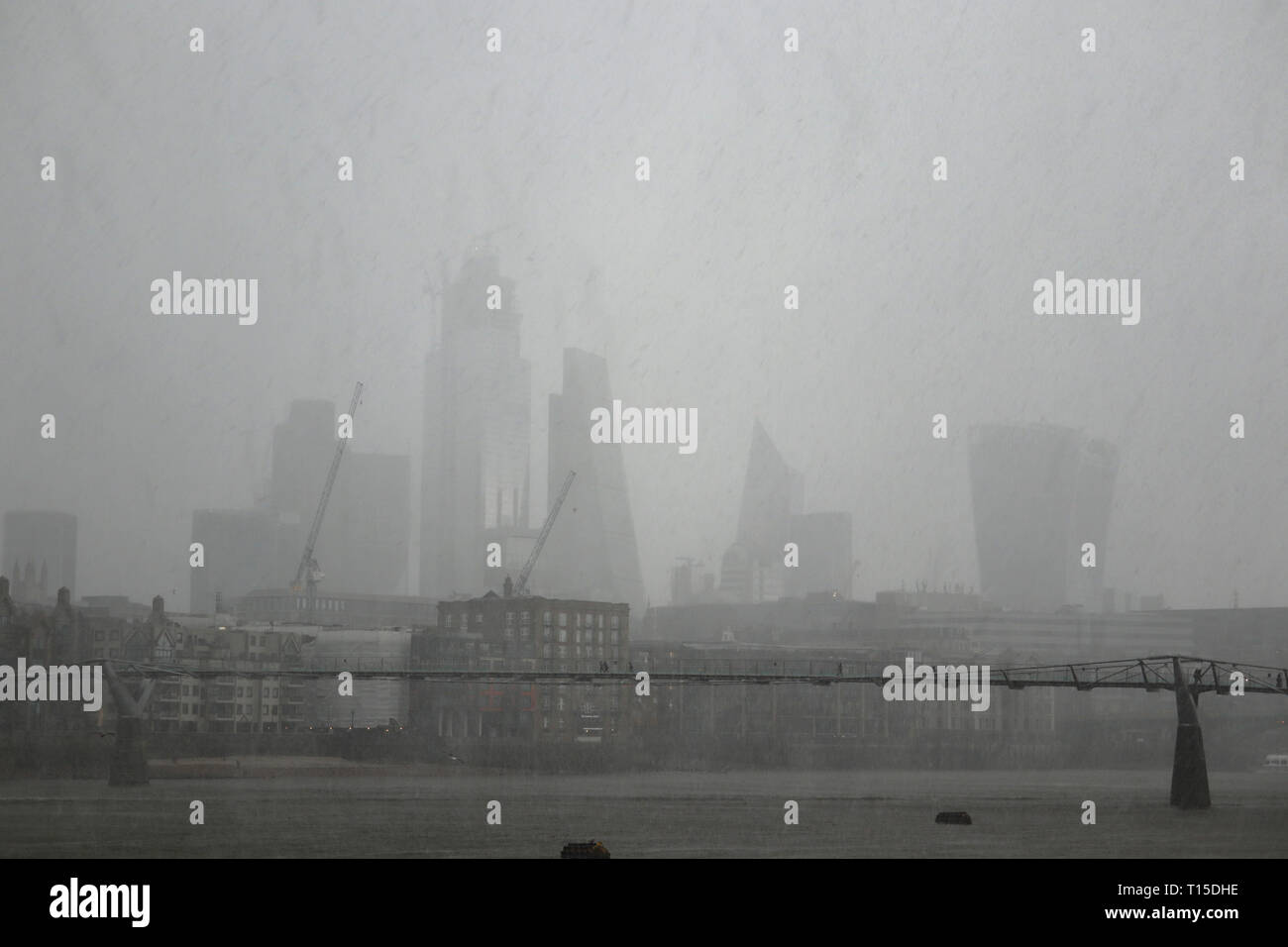 hailstone-storm-over-river-thames-millenium-bridge-city-of-london-england-uk-T15DHE.jpg