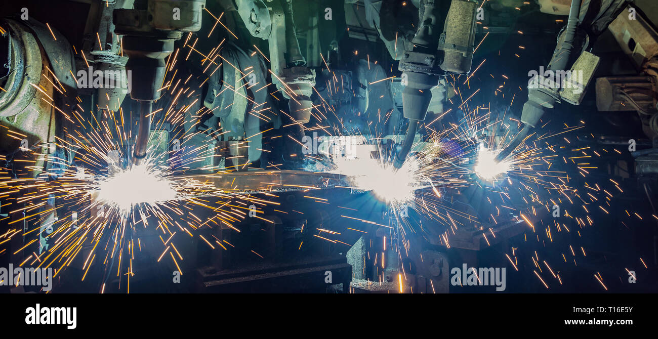industrial robot are welding in factory Stock Photo