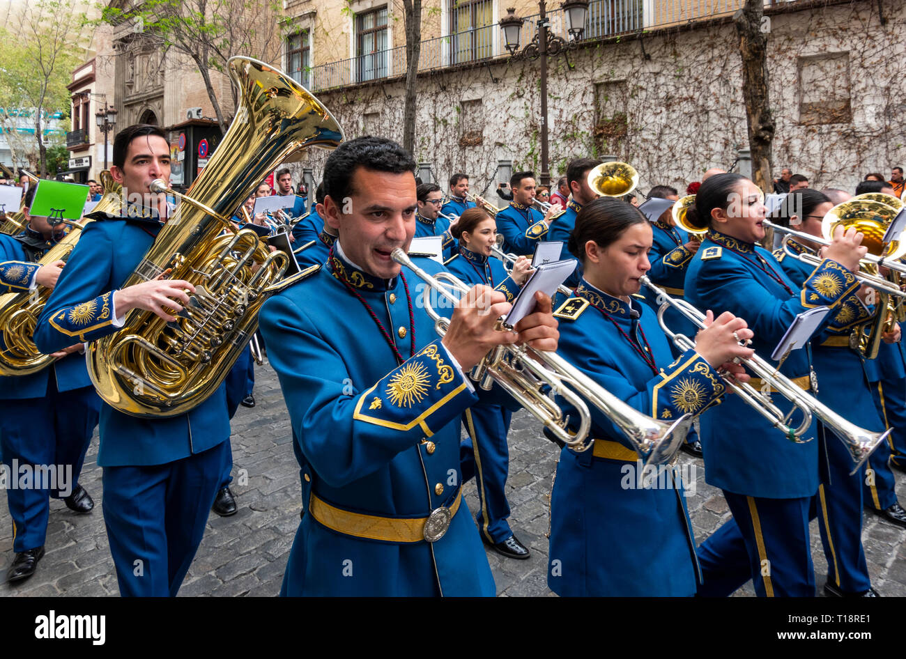 a-marching-band-on-a-street-in-seville-s