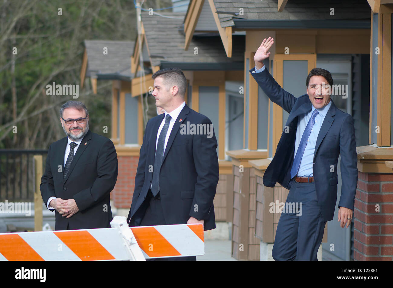 Canadian Prime Minister Justin Trudeau (waving) and Dan Ruimy, Ridge/Meadows MP representative in the House of Commons (left). Security in center. Stock Photo