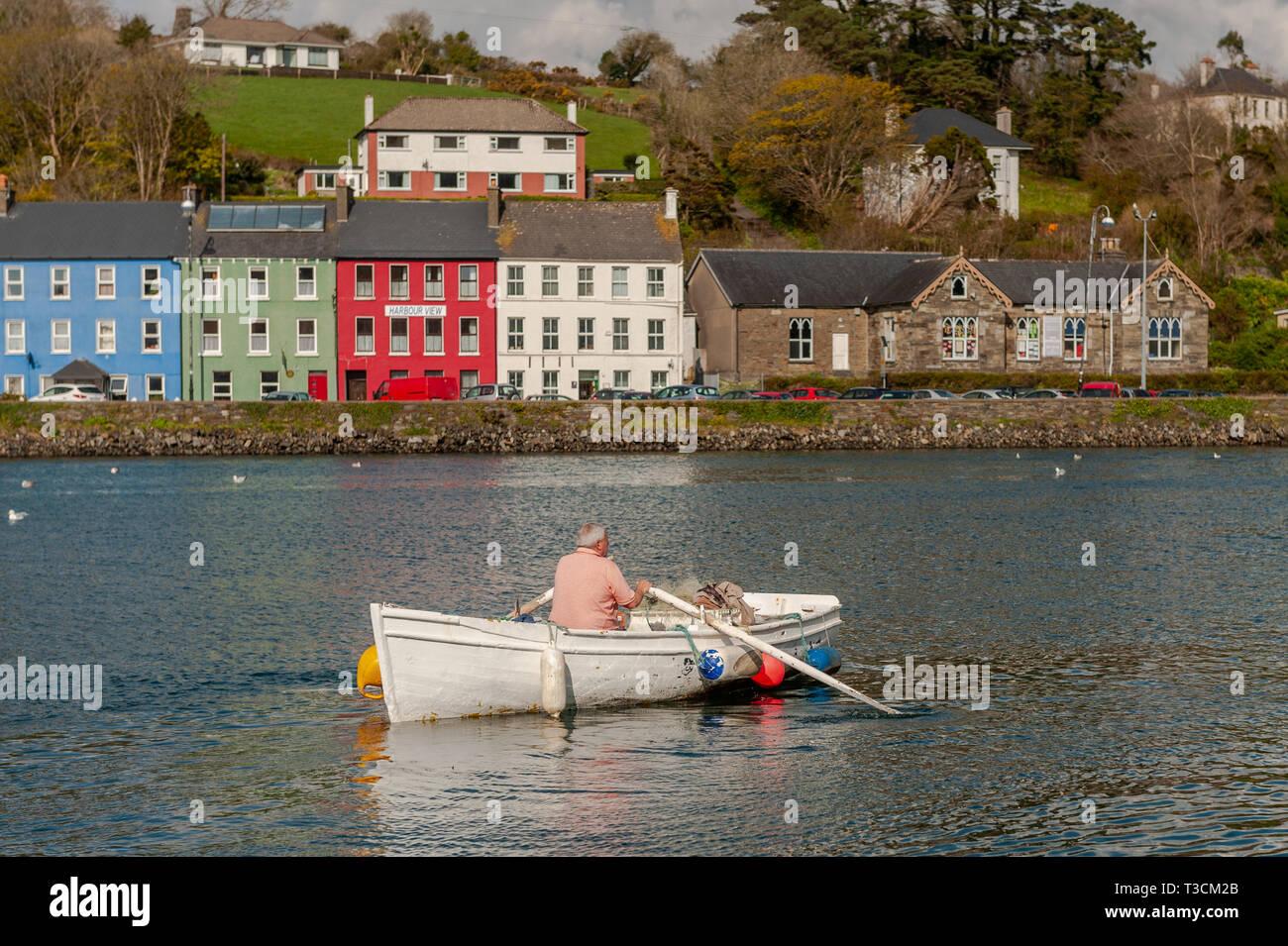 fisherman-rowing-a-boat-in-bantry-harbour-west-cork-ireland-T3CM2B.jpg