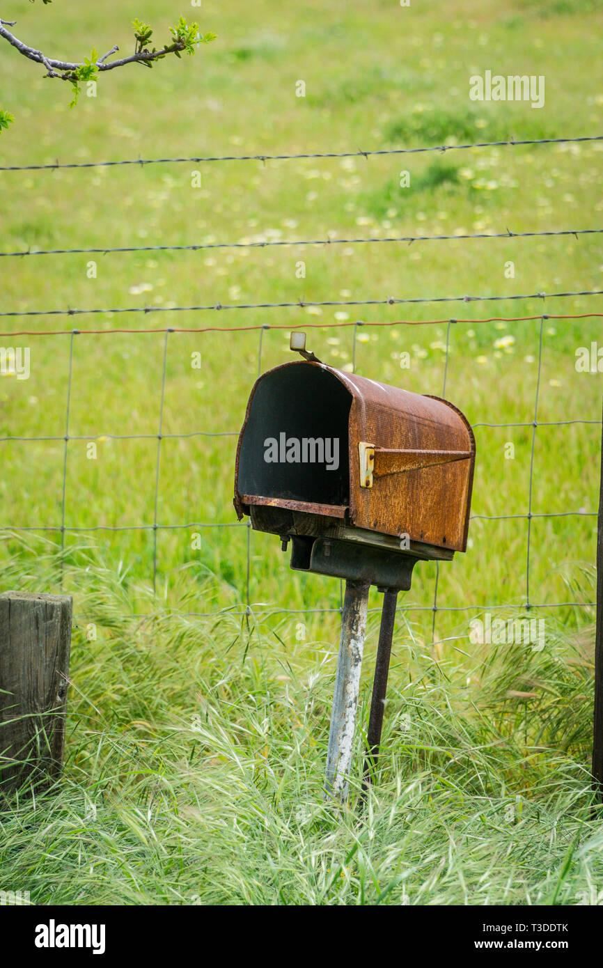 An old empty mailbox in Central California's Diablo Mountain Range spring 2019 USA Stock Photo