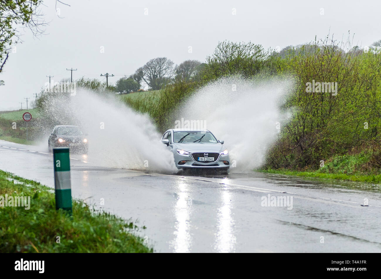 skibbereen-west-cork-ireland-15th-apr-2019-much-of-ireland-is-currently-in-the-midst-of-a-status-orange-rainfall-warning-issued-by-met-ireann-a-car-races-through-a-spot-flood-on-the-n71-near-skibbereen-credit-andy-gibsonalamy-live-news-T4A1FR.jpg