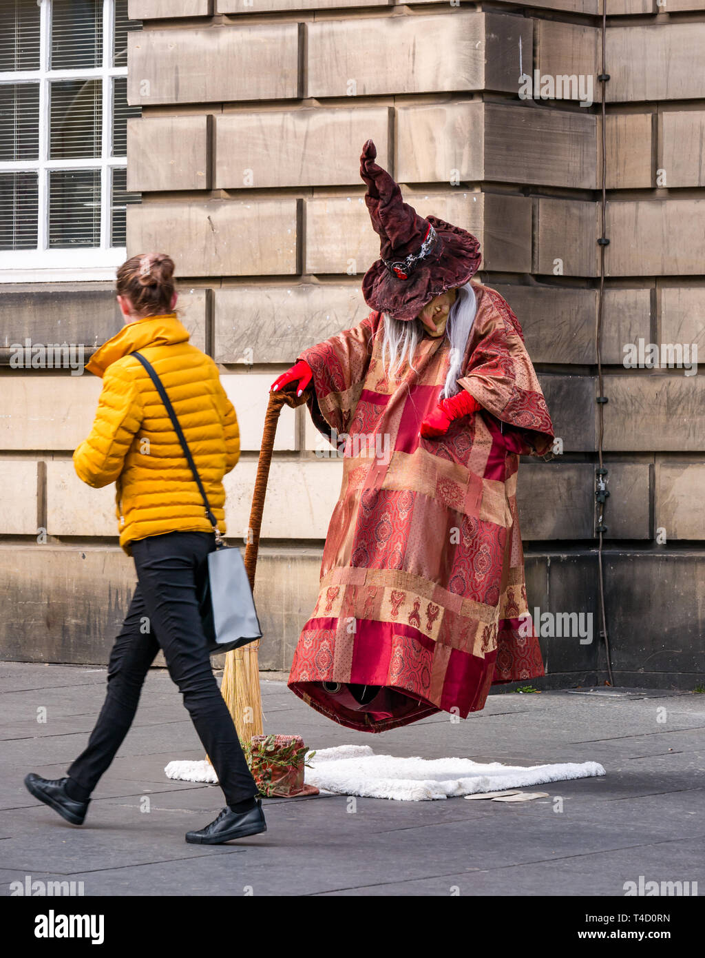 woman-walking-past-witch-and-broomstick-