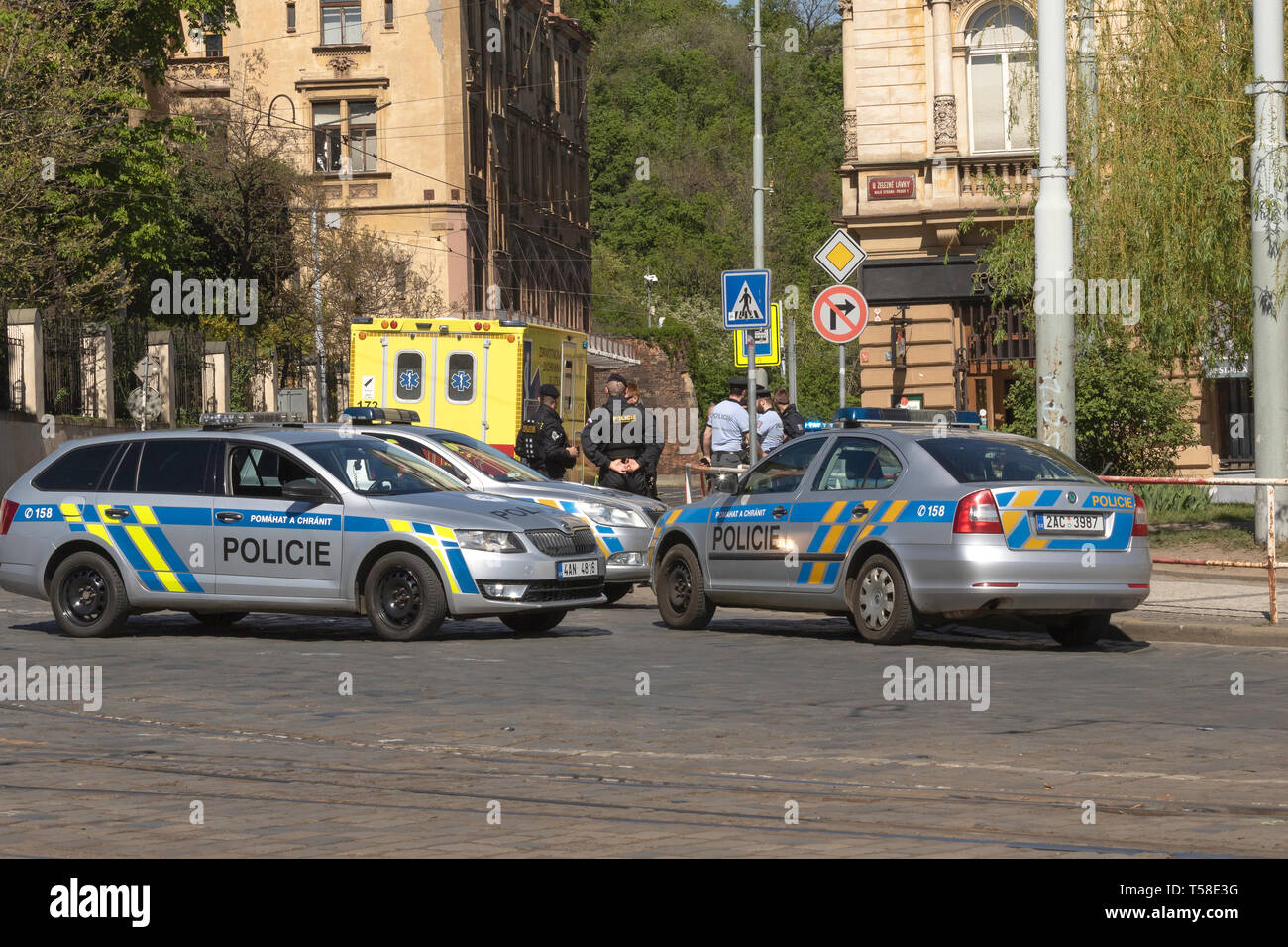 Accident across the entrance to the Royal Gardens in Prague districk Malostranska Europe. Police and ambulance and the city architecture. - Stock Image