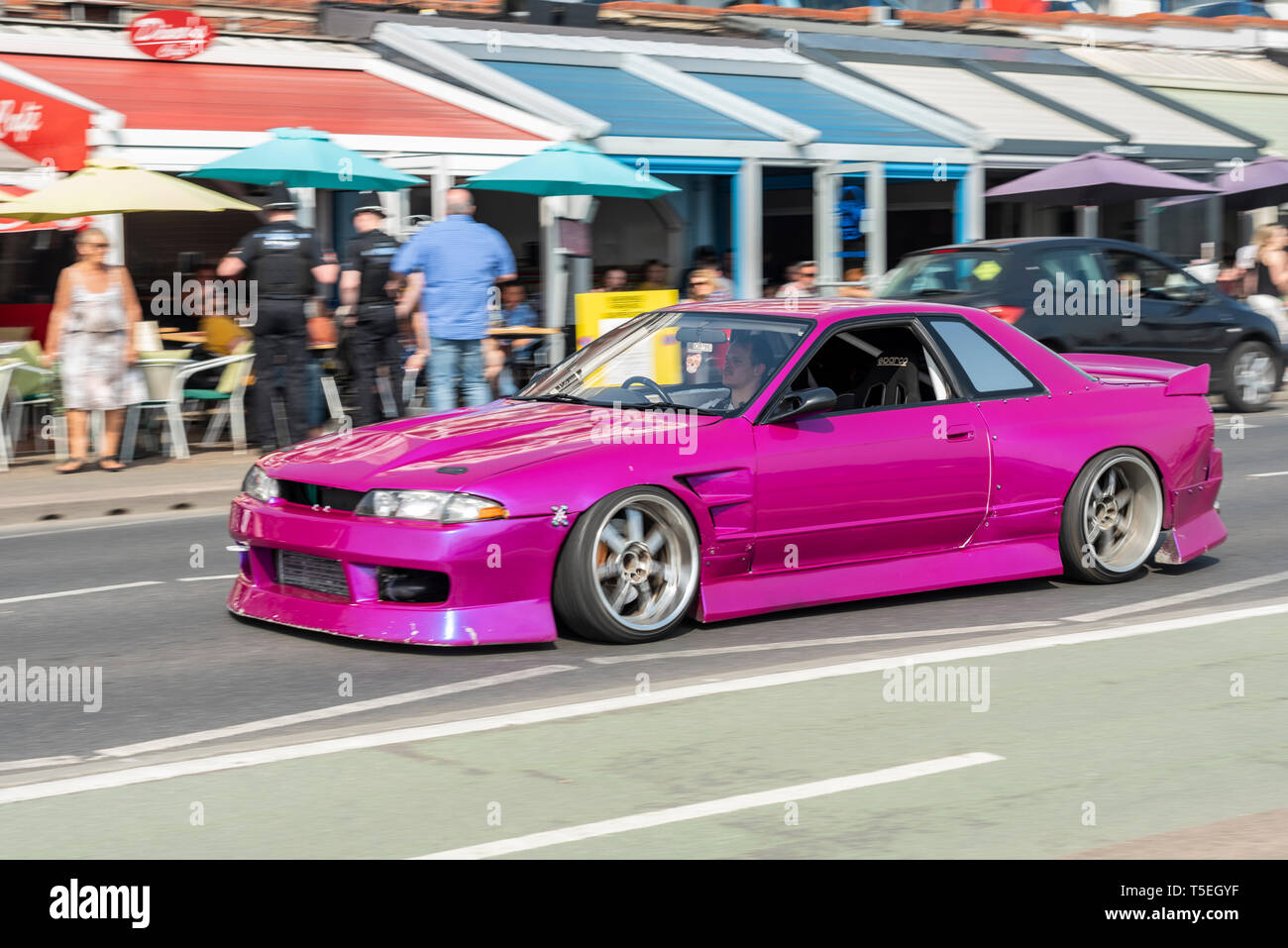 magenta-custom-car-driving-past-arches-restaurants-along-western-esplanade-southend-on-sea-essex-uk-lowered-modified-nissan-silvia-vehicle-T5EGYF.jpg