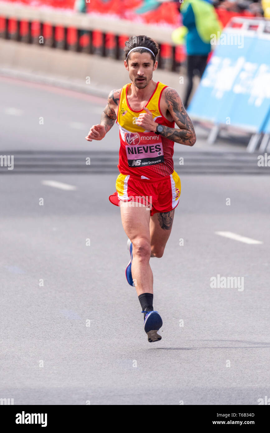 gustavo-nieves-racing-in-the-virgin-money-london-marathon-2019-near-tower-bridge-london-uk-space-for-copy-T6B34D.jpg