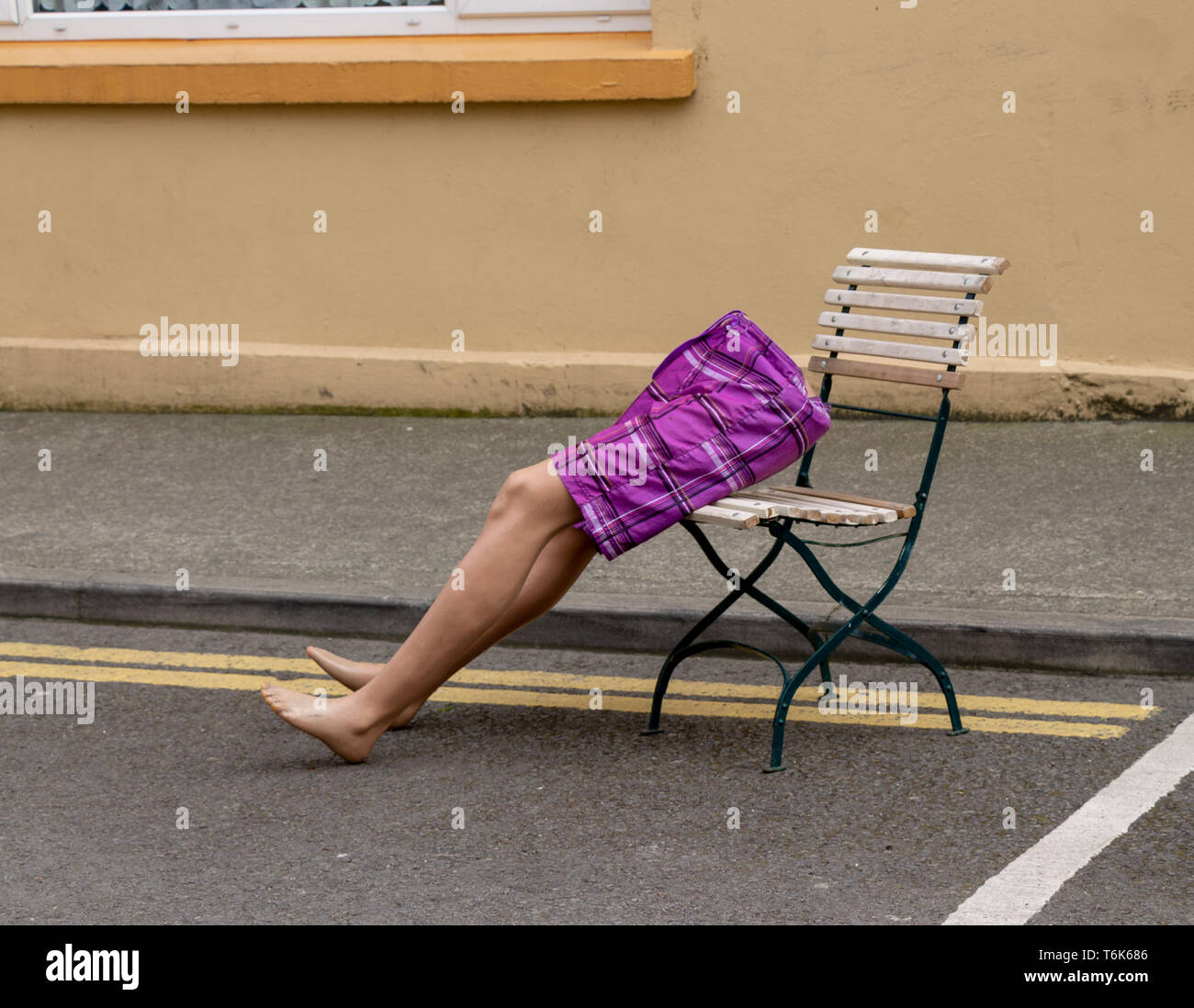 bottom-half-of-a-tailors-dummy-wearing-purple-shorts-sat-on-a-chair-in-the-road-T6K686.jpg