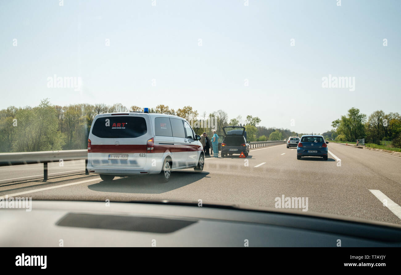 France - Apr 19, 2019: Driver poit of view POV at french Ambulance offering assistance to car involved in road highway autoroute accident with no or little injuries - Stock Image