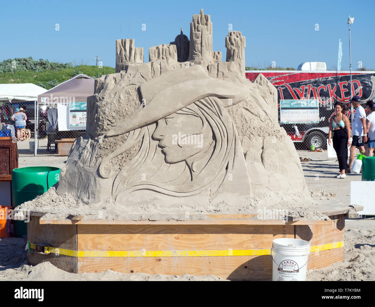 "Delayne Corbett""s unfinished sand sculpture, ""She's a Little Bit City and a Little Bit Country,"" at the 2019 Texas Sandfest. Port Aransas, Texas USA. Stock Photo"