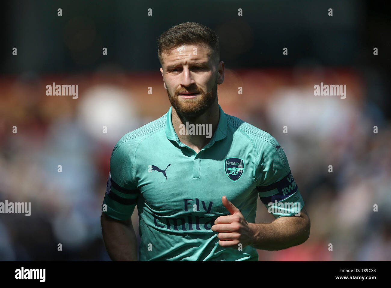 burnley-uk-12th-may-2019-shkodran-mustafi-of-arsenal-looks-on-premier-league-match-burnley-v-arsenal-at-turf-moor-in-burnley-lancashire-on-sunday-12th-may-2019-this-image-may-only-be-used-for-editorial-purposes-editorial-use-only-license-required-for-commercial-use-no-use-in-betting-games-or-a-single-clubleagueplayer-publications-credit-andrew-orchard-sports-photographyalamy-live-news-T89CX3.jpg