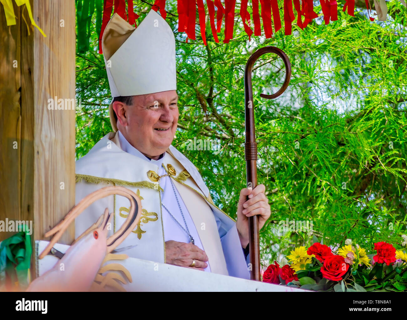 Catholic Archbishop Thomas J. Rodi waits to deliver the blessing of the boats during the 70th annual Blessing of the Fleet in Bayou La Batre, Alabama. Stock Photo