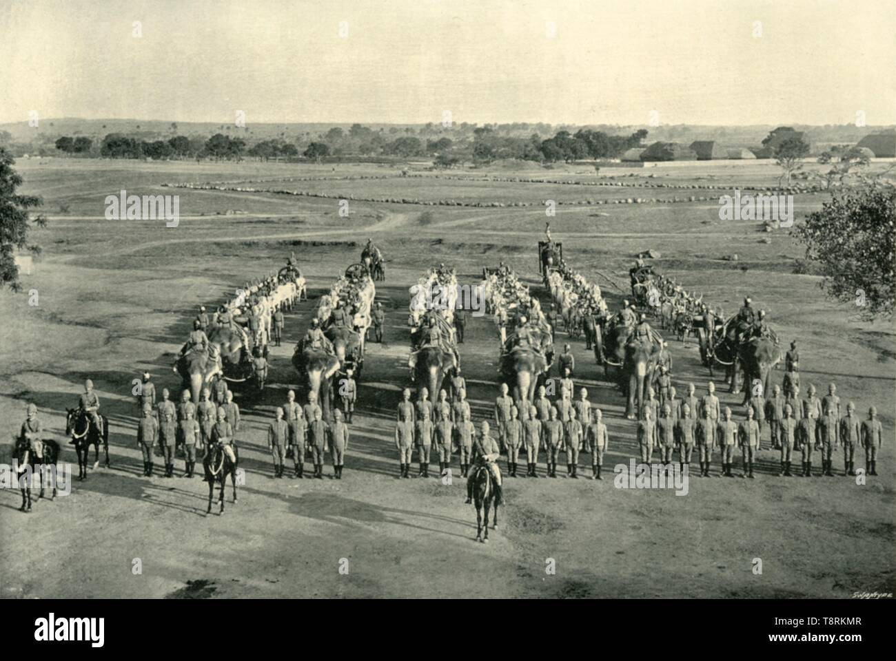 "'An Elephant Battery, ""Camp of Exercise"", Rawal Pindi', c1890, (1901). British and Indian soldiers with elephants at Rawalpindi in India, (now Pakistan). From ""The Life and Deeds of Earl Roberts, Vol. III. - To The End of Lord Roberts's Indian Career"", by J. Maclaren Cobban. [T. C. & E. C. Jack, Edinburgh, 1901] - Stock Image"