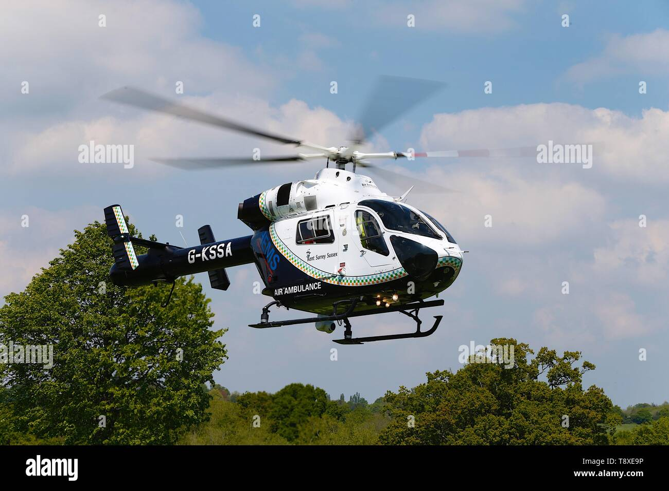 Tenterden, Kent, UK. 15th May, 2019. A Kent Surrey Sussex air ambulance has been dispatched to an incident in the town centre. Medical staff are at scene. The emergency has taken place at the Old Dairy Brewery just off the high street in the town centre. The MD902 Explorer helicopter takes off into the air. Credit: Paul Lawrenson 2019, Photo Credit: Paul Lawrenson/Alamy Live News Stock Photo