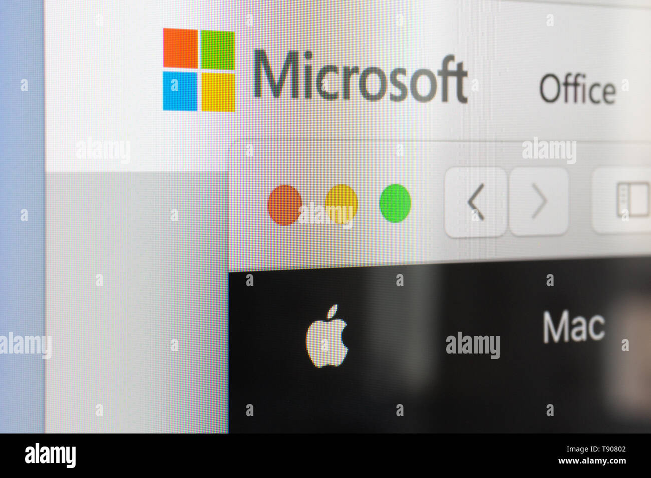 HUNGARY - SEPTEMBER 17, 2018: Microsoft and Apple websites in browser side by side on screen Stock Photo