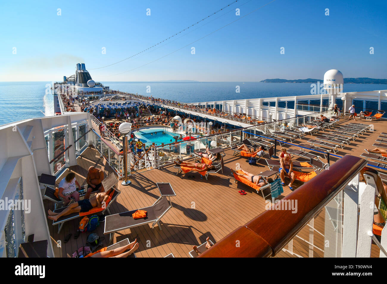 a-large-cruise-ship-with-tourists-on-deck-approaches-the-island-of-corfu-greece-on-a-summer-day-in-the-ionian-sea-T90WN4.jpg