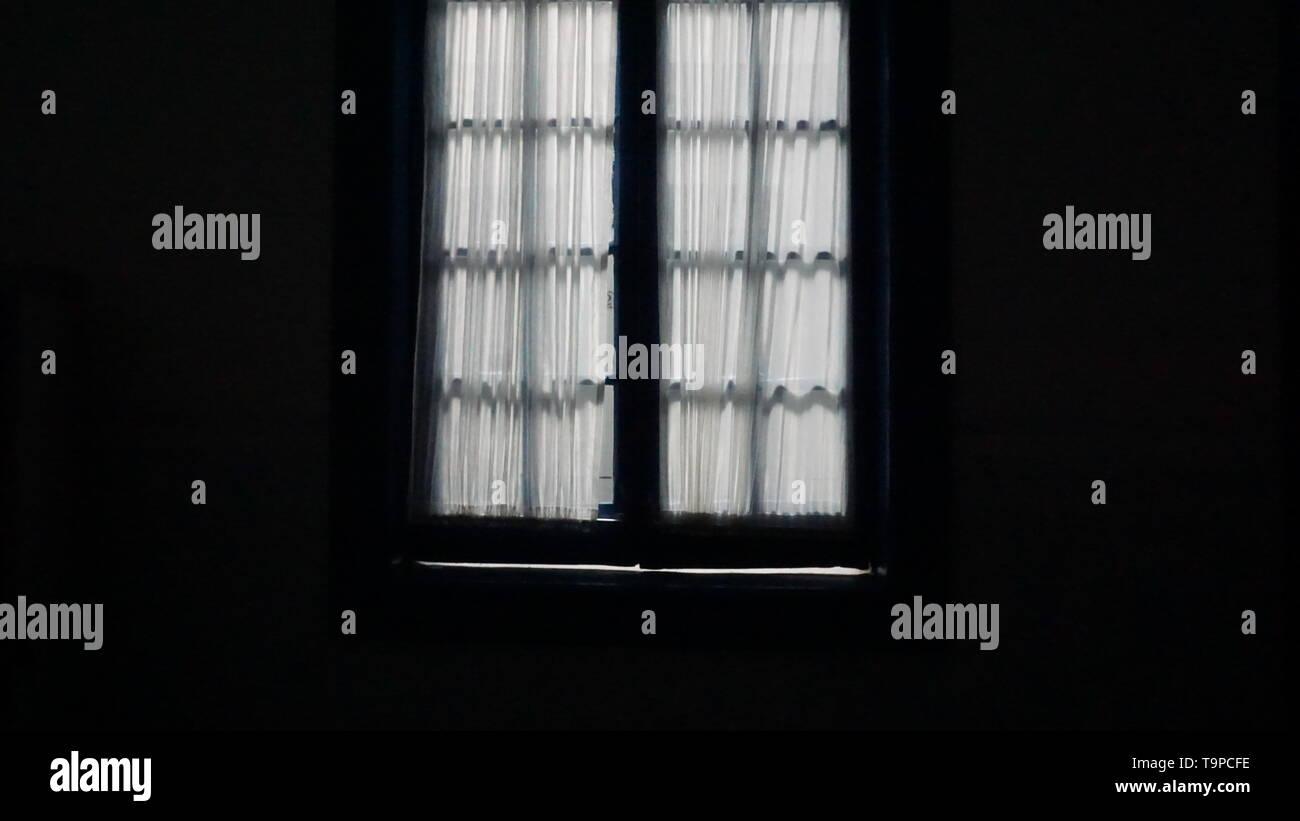 white-sheer-curtains-over-casement-windows-dark-inside-bright-light-outside-a-metaphor-for-isolation-agoraphobia-or-privacy-T9PCFE.jpg