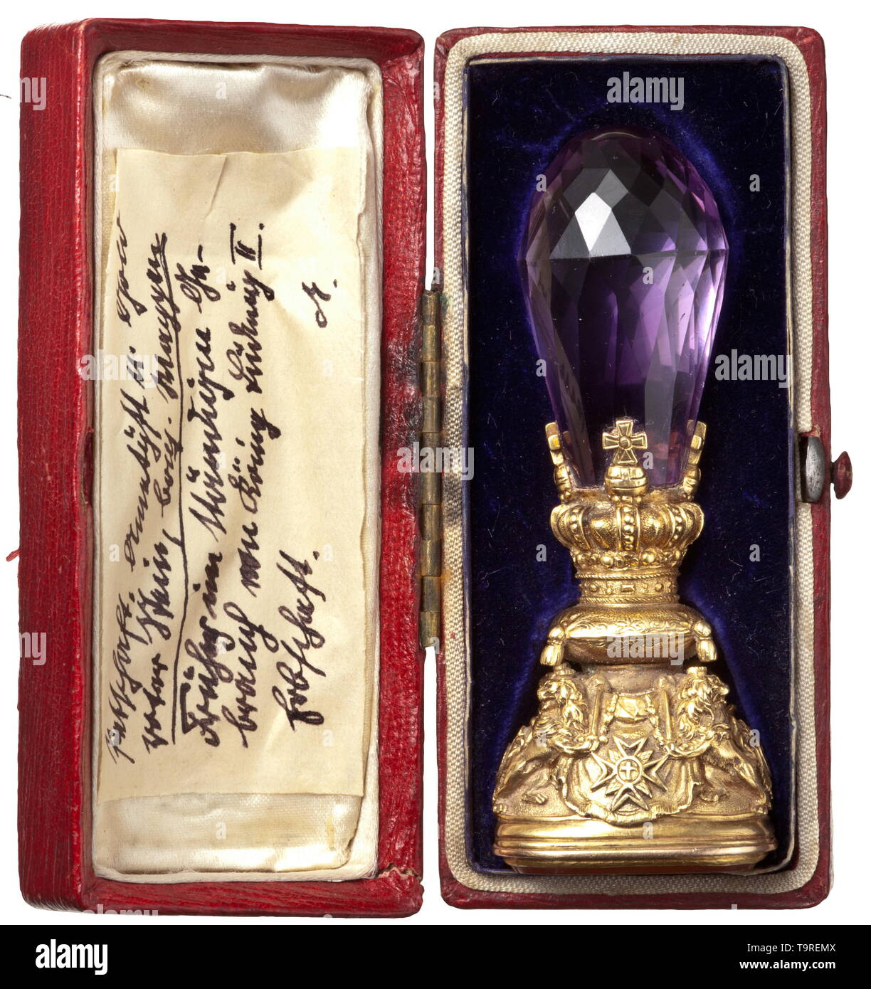 King Ludwig II of Bavaria (1845 - 1886) - a royal sea l Golden mounting decorated in relief, the handle formed of a large cut amethyst, the seal surface made from a rectangular carnelian with the deeply chiselled, large Bavarian state coat of arms above the collars of the order, surmounted by the ermine coat and crown. The golden mounting consists of the Bavarian royal crown on the coronation cushion, carried by the Bavarian lions armed with swords, with the House Knight's Order of St. Hubert, the Military House Knight's Order of St. George, the , Additional-Rights-Clearance-Info-Not-Available Stock Photo