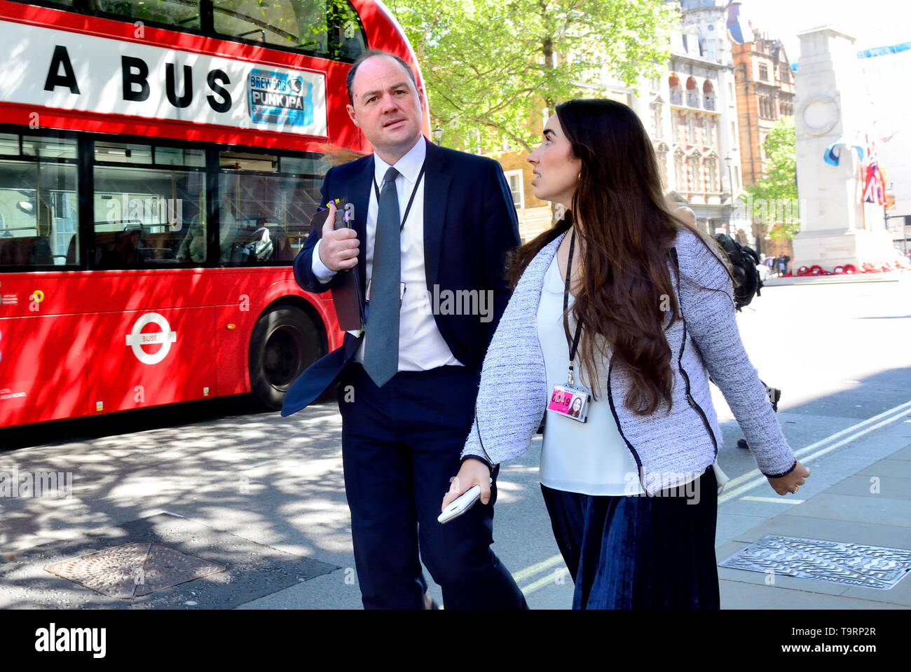 James Slack (official spokesman for 10 Downing Street) and Katie Smith (Senior Press Officer at Prime Minister's Office) in Whitehall, by a bus, May 2 Stock Photo