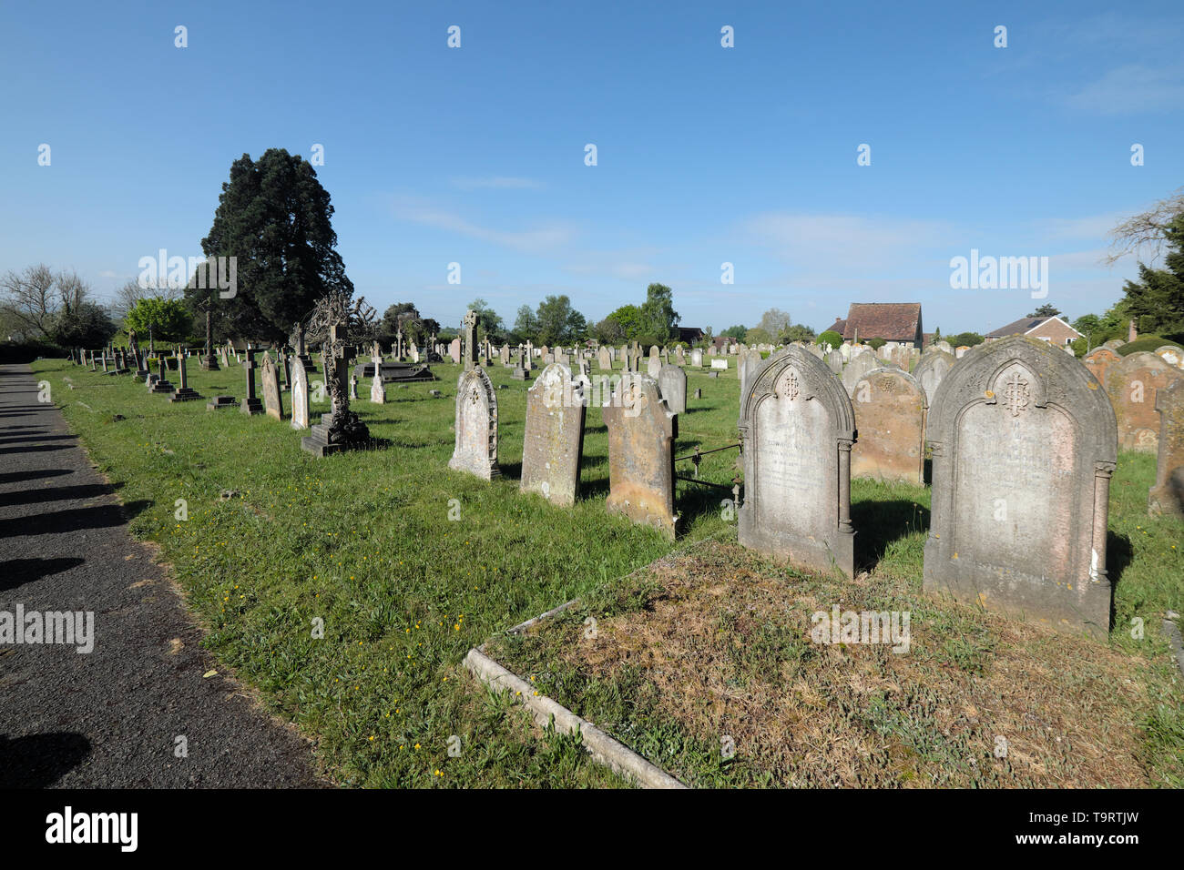 the parish church and graveyard in the west sussex village of cuckfield Stock Photo