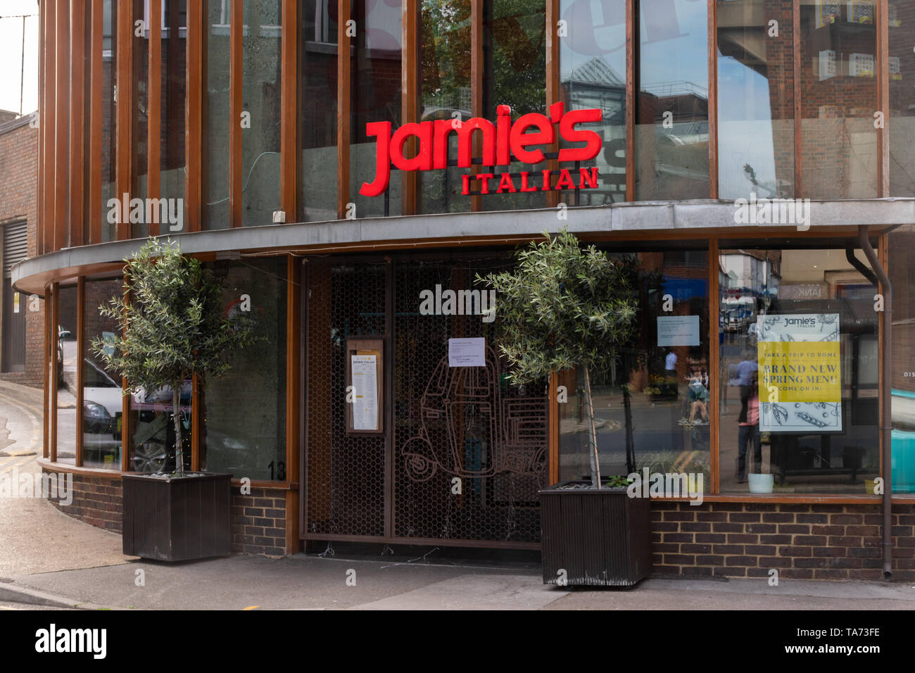 jamies-italian-restaurant-in-the-surrey-town-of-guildford-has-closed-due-to-the-restaurant-chain-owned-by-chef-jamie-oliver-going-into-administration-a-notice-appeared-on-21st-may-2019-on-the-front-door-explaining-that-the-restaurant-has-now-closed-and-naming-the-administrators-TA73FE.jpg
