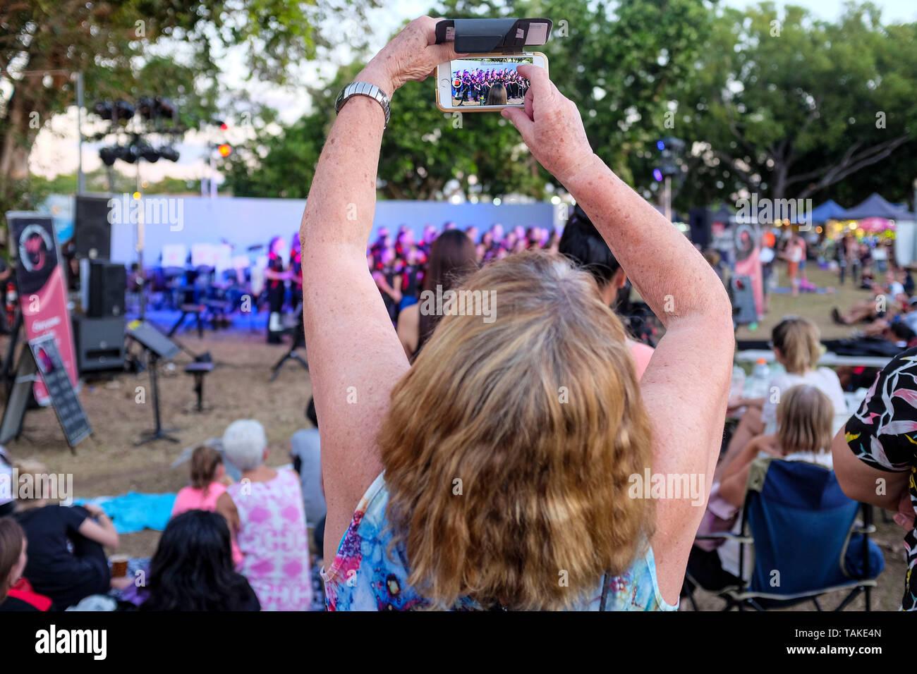 grandmother-filming-a-children-choir-wit