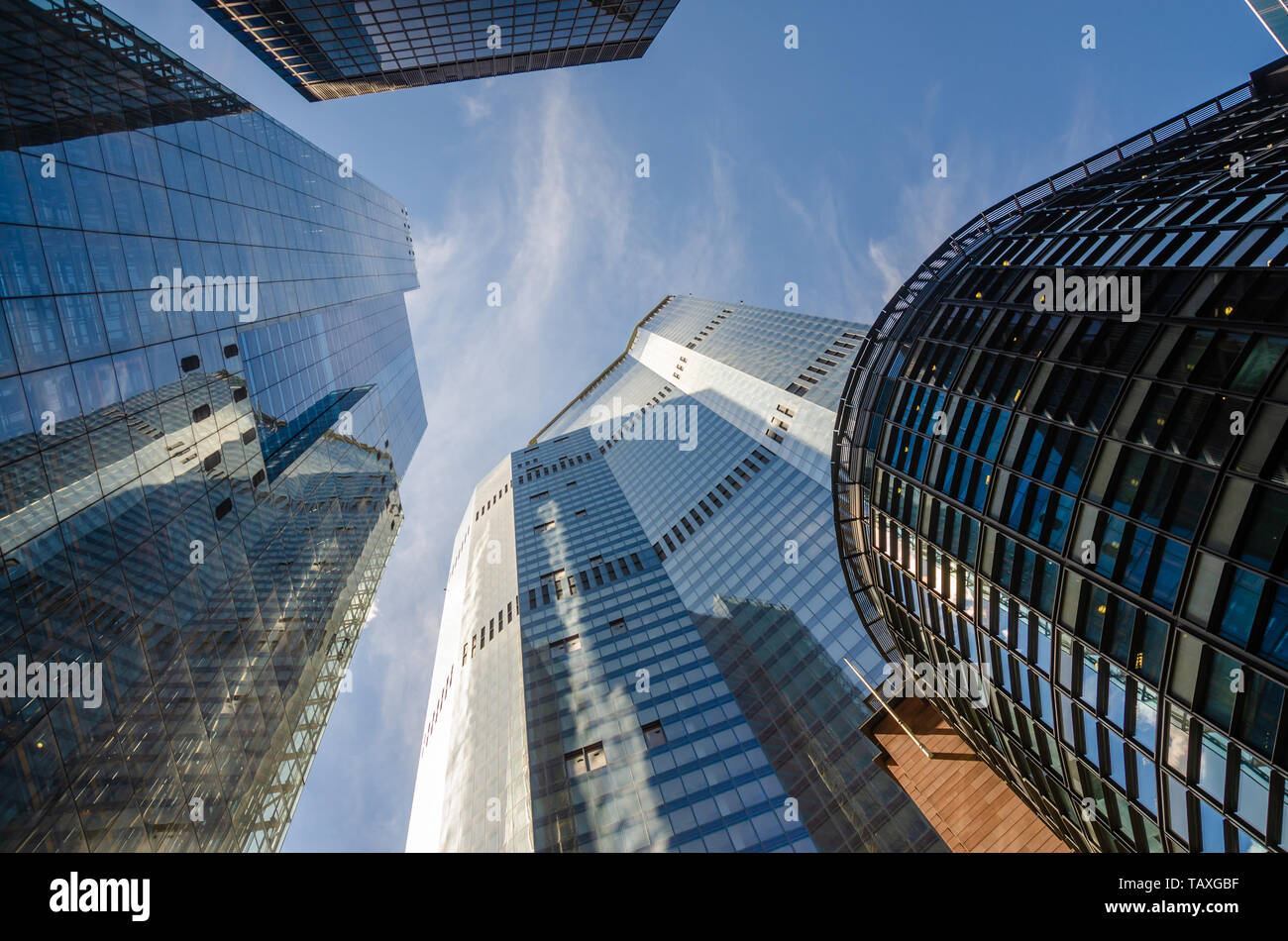 a-view-looking-up-at-skyscrapers-in-the-financial-district-of-the-city-of-london-TAXGBF.jpg