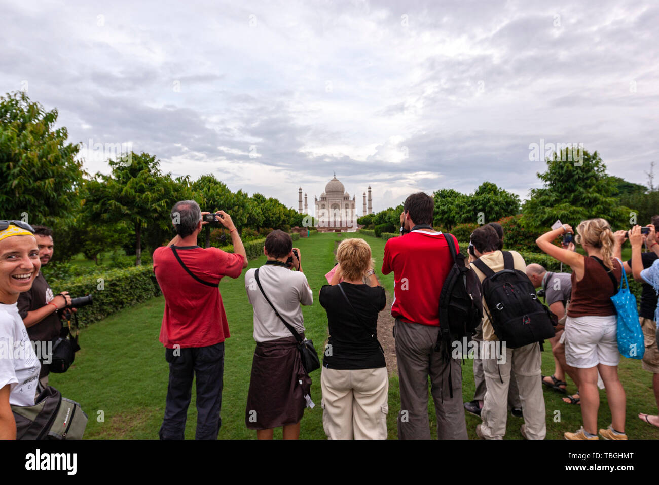 Tourists taking pictures from Mehtab Bagh, Taj Mahal View Point, Agra, Uttar Pradesh, India Stock Photo