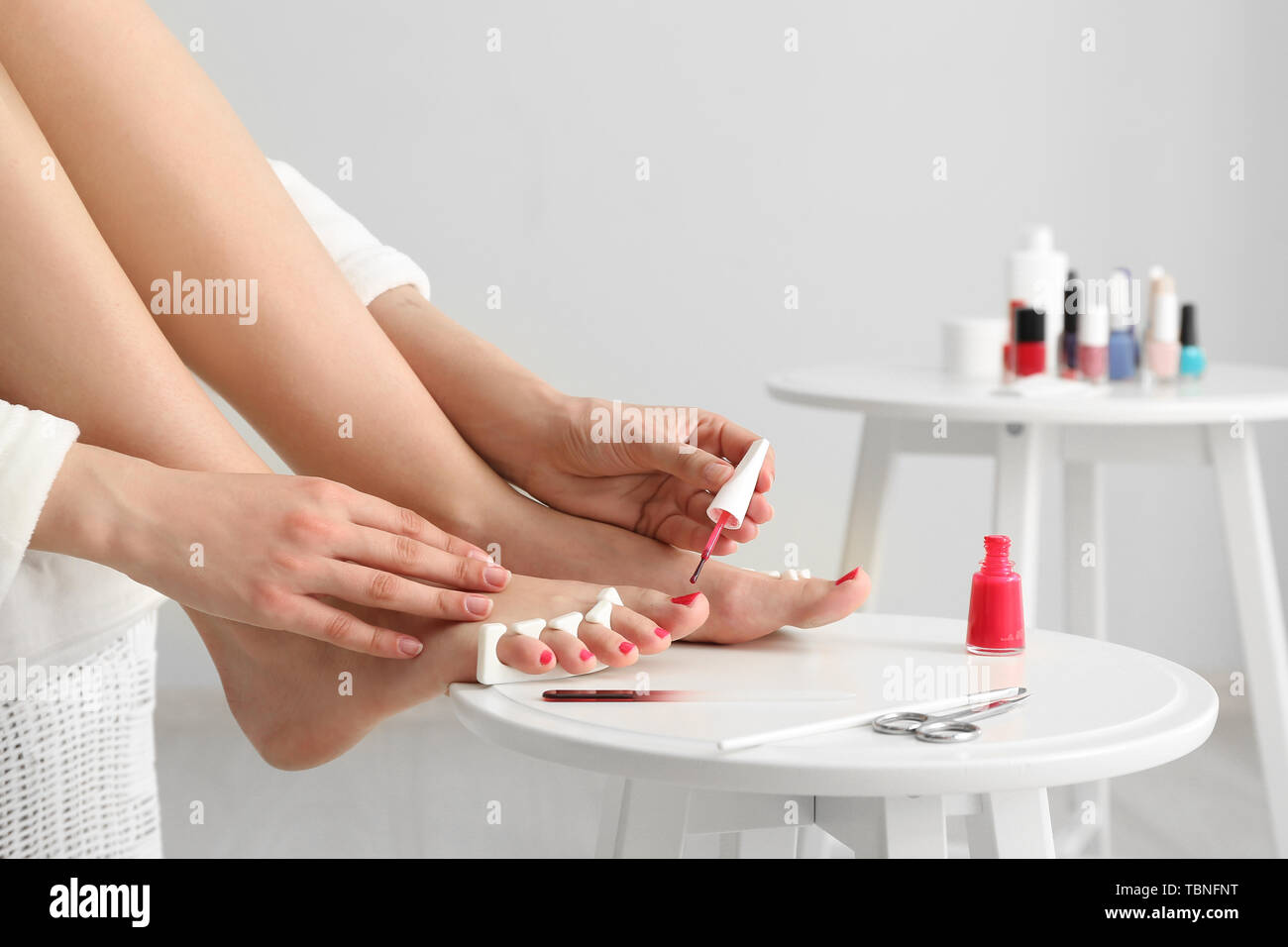 Woman doing pedicure at home Stock Photo