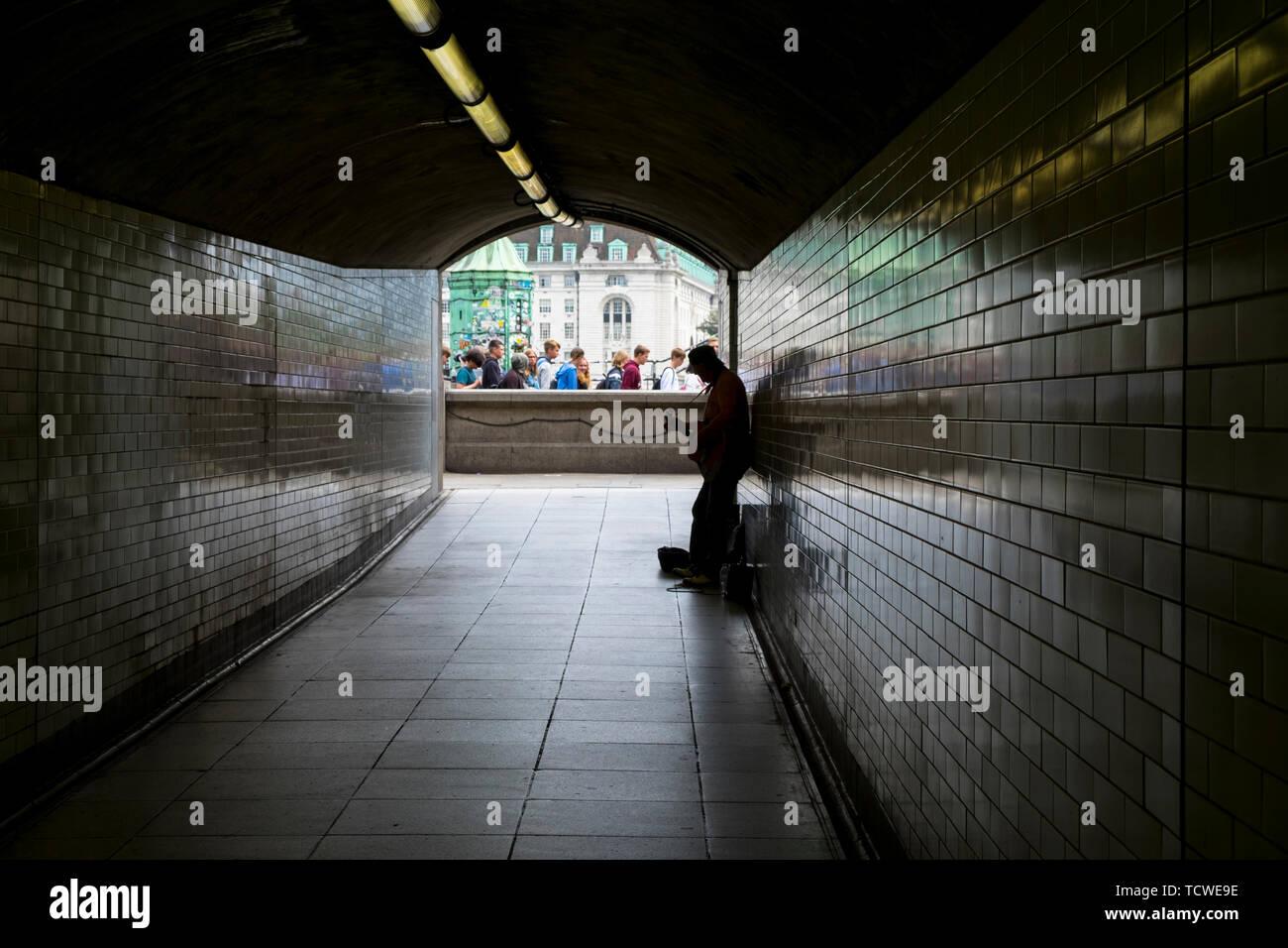 Busker in an underground passageway, london, uk Stock Photo