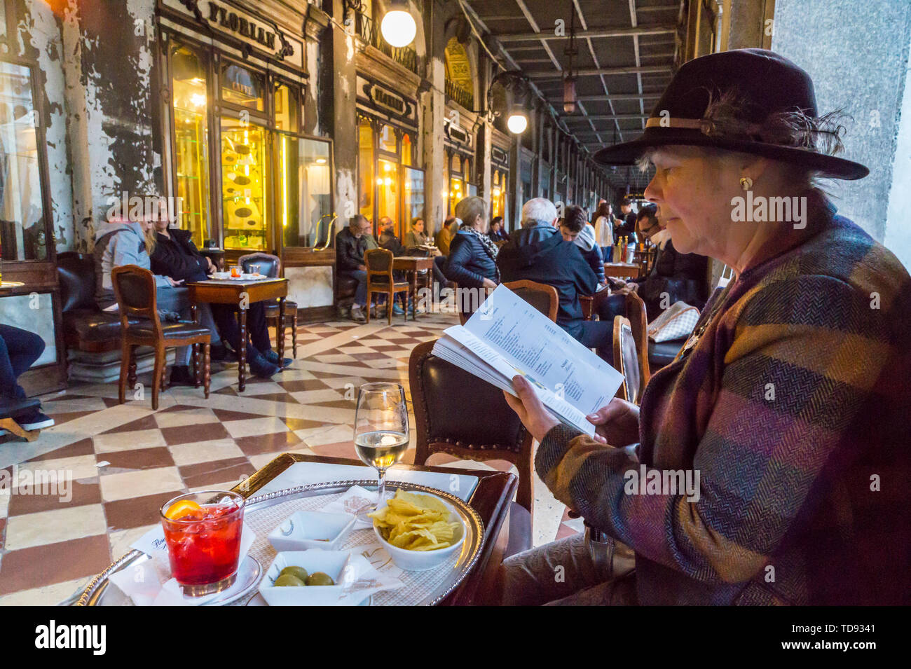 a-woman-looking-at-the-menu-at-caff-florian-st-marks-square-san-marco-venice-veneto-italy-TD9341.jpg