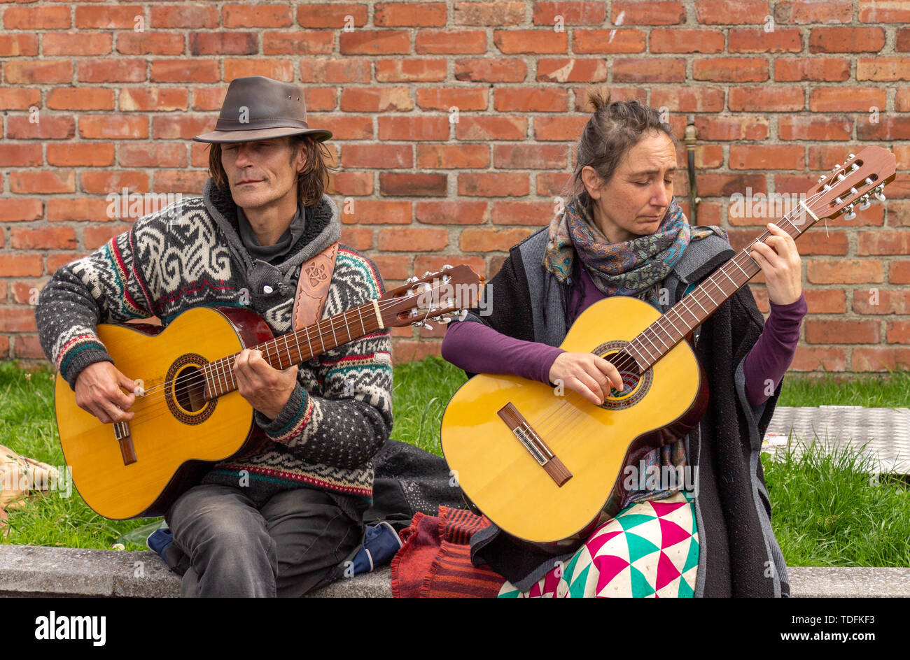 male-and-female-playing-acoustic-guitars-TDFKF3.jpg