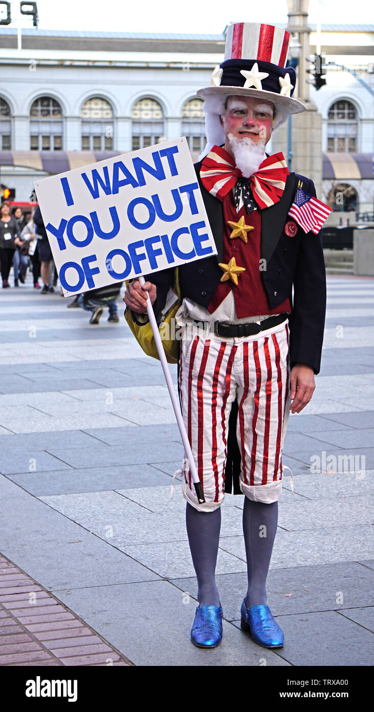 Protester in Uncle Sam costume with sign in front of Embarcadero Building.  2019 Women's March, Anti-Trump Protest, San Francisco, California, USA. Stock Photo