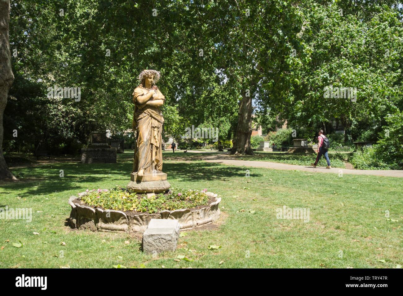 Terracotta statue of Euterpe the Muse of instrumental music, in St George's Garden's, Camden, London, UK Stock Photo