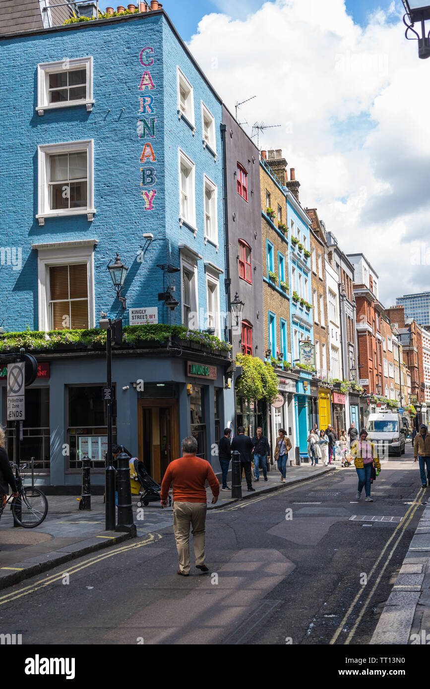 View along Beak Street, between Kingly Street and Carnaby Street, Soho, London Stock Photo