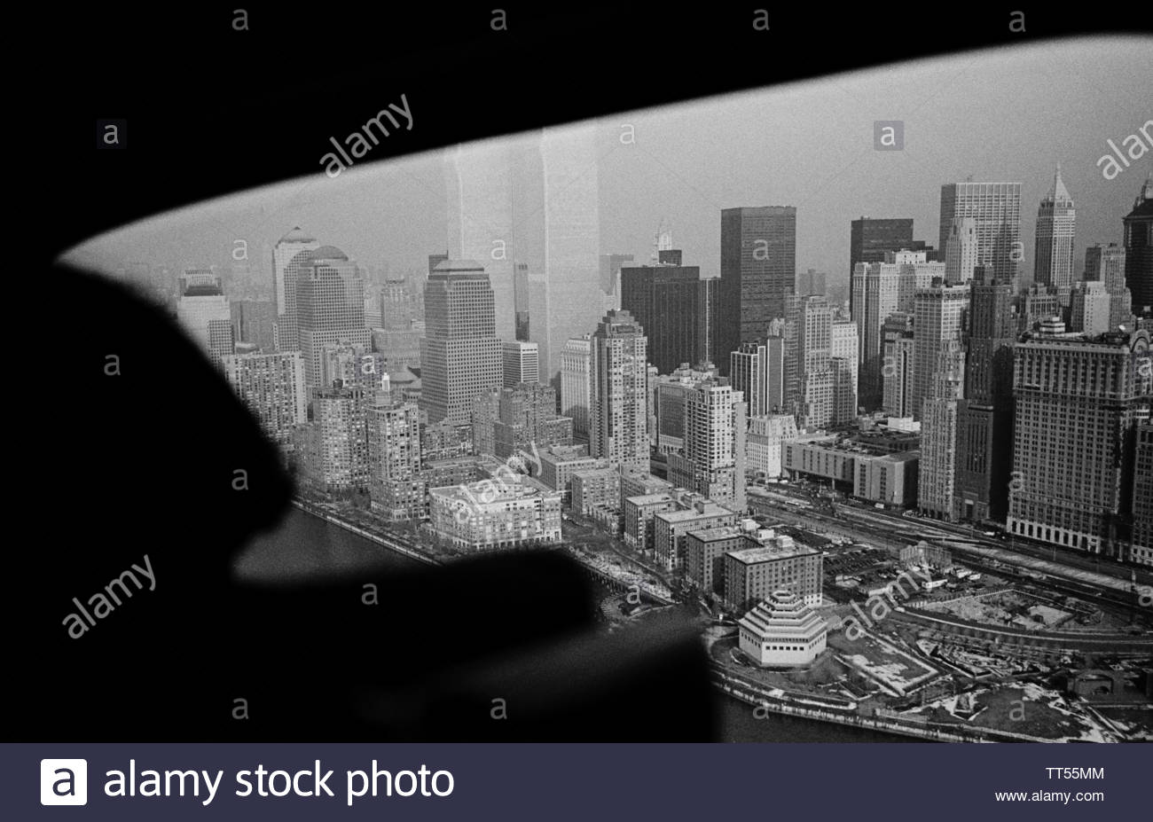 view-from-a-helicopter-looking-down-on-to-lower-manhattan-world-trade-center-towers-present-new-york-city-usa-TT55MM.jpg