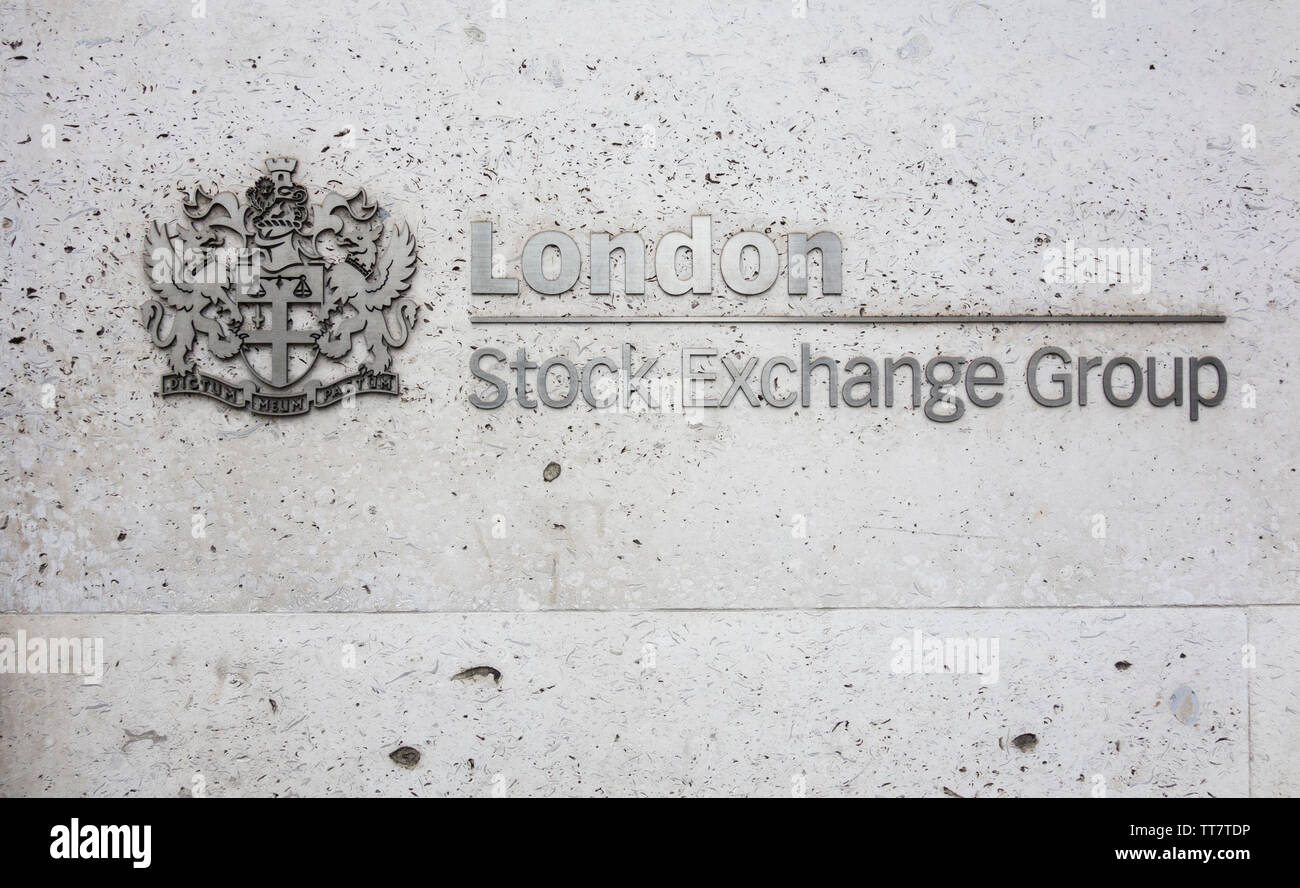 Signage outside the London Stock Exchange coat of arms - My Word is My Bond (Dictum Meum Pactum), outside the LSE on Paternoster Row, London, EC4, UK Stock Photo