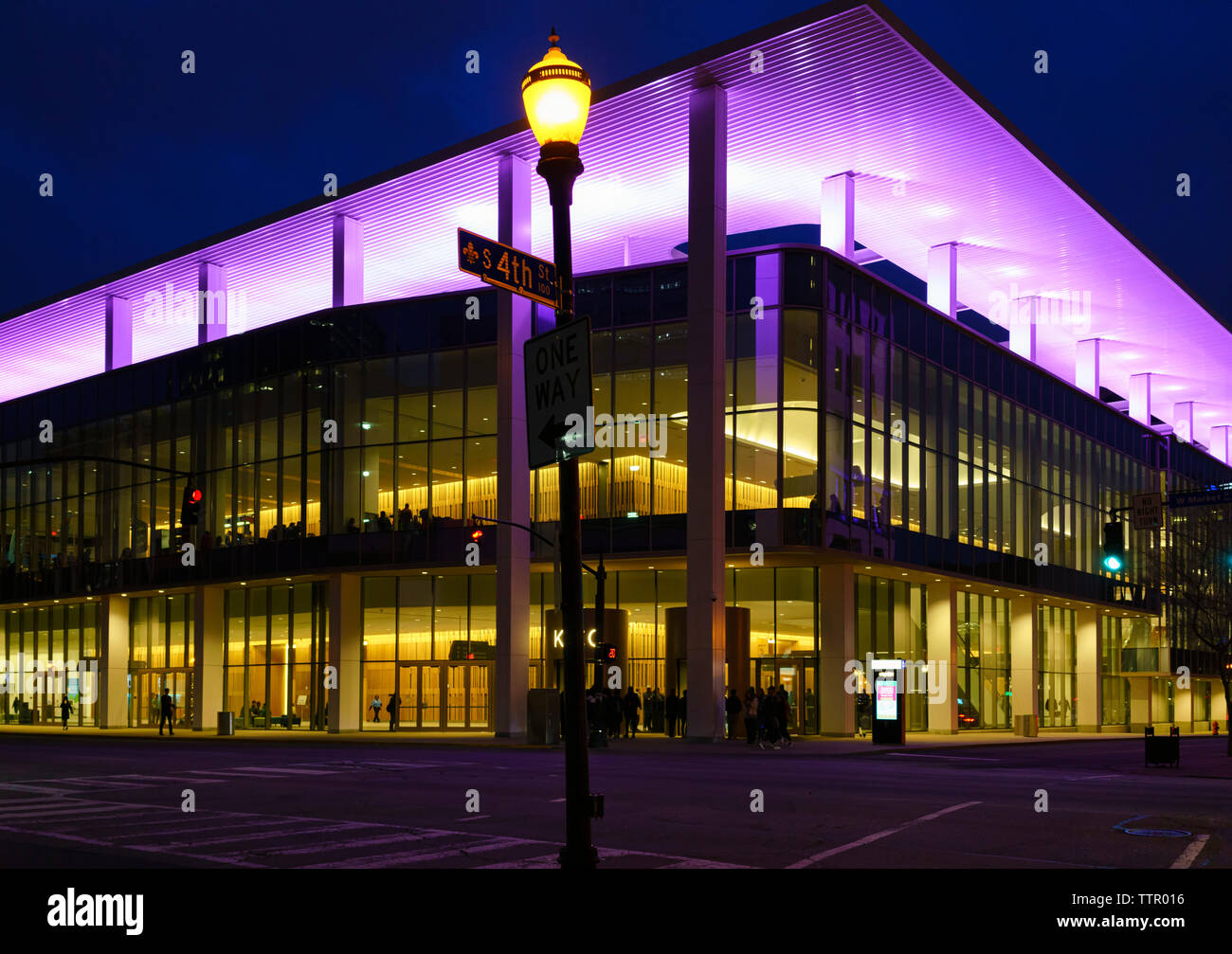 The Kentucky International Convention Center (KICC) with purple lights lit up at night. Built in 1977, it reopened in 2018 after renovations. Stock Photo