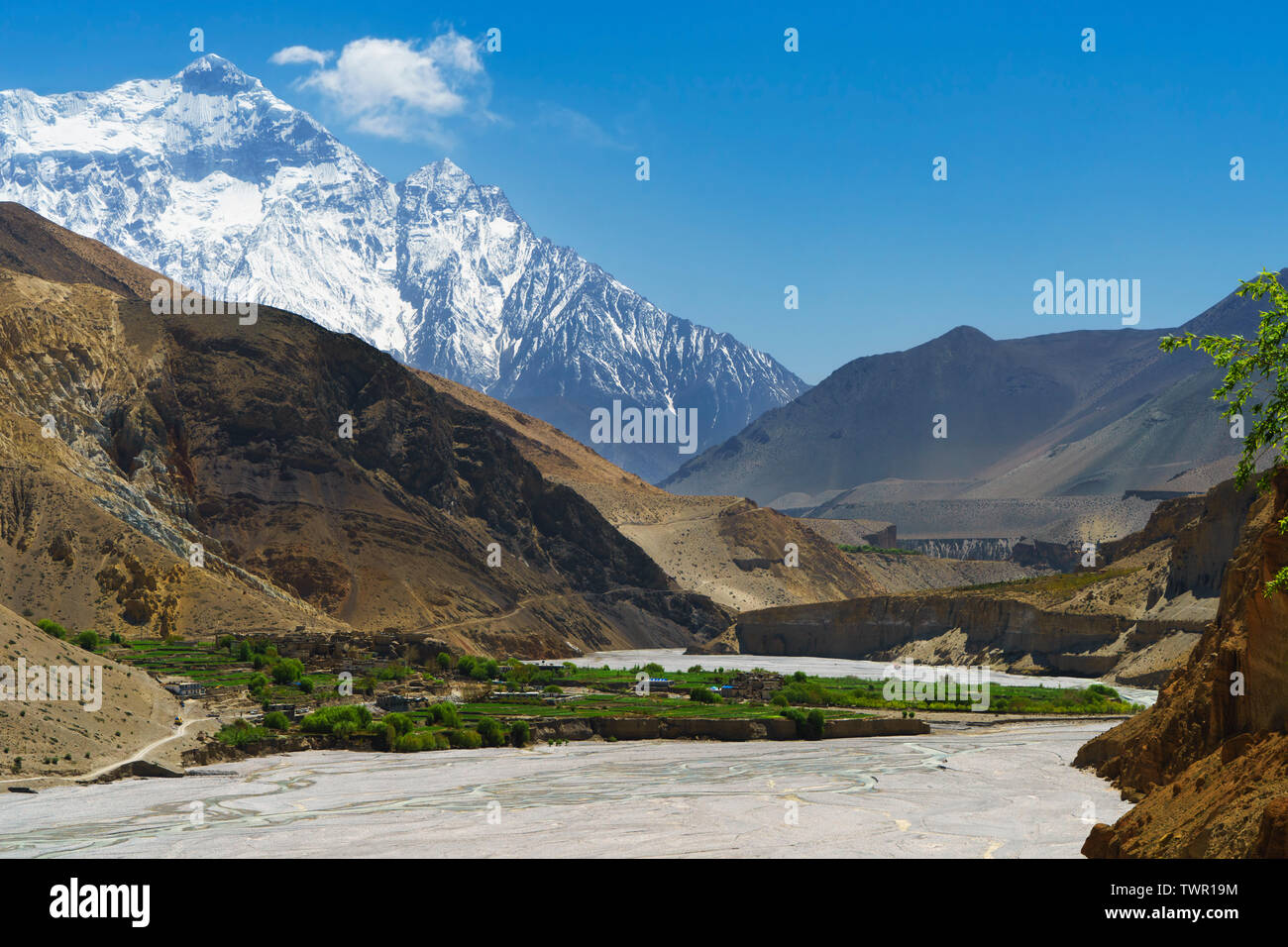 viewed-from-a-distance-ancient-village-of-chuksang-in-the-kali-gandaki-valley-upper-mustang-region-nepal-nilgiri-north-7061m-in-the-background-TWR19M.jpg