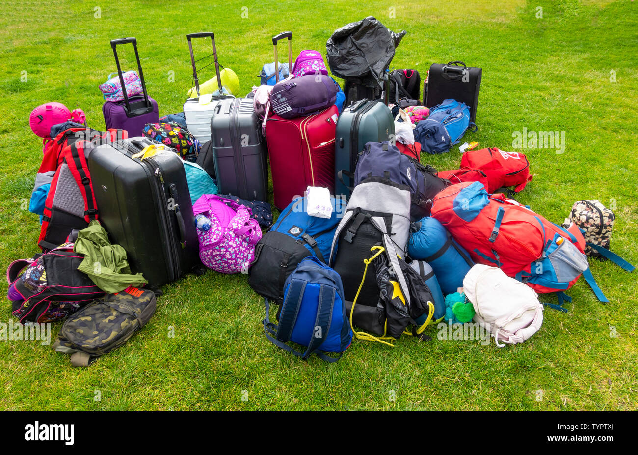 a-tour-groups-luggage-sits-on-the-lawn-a