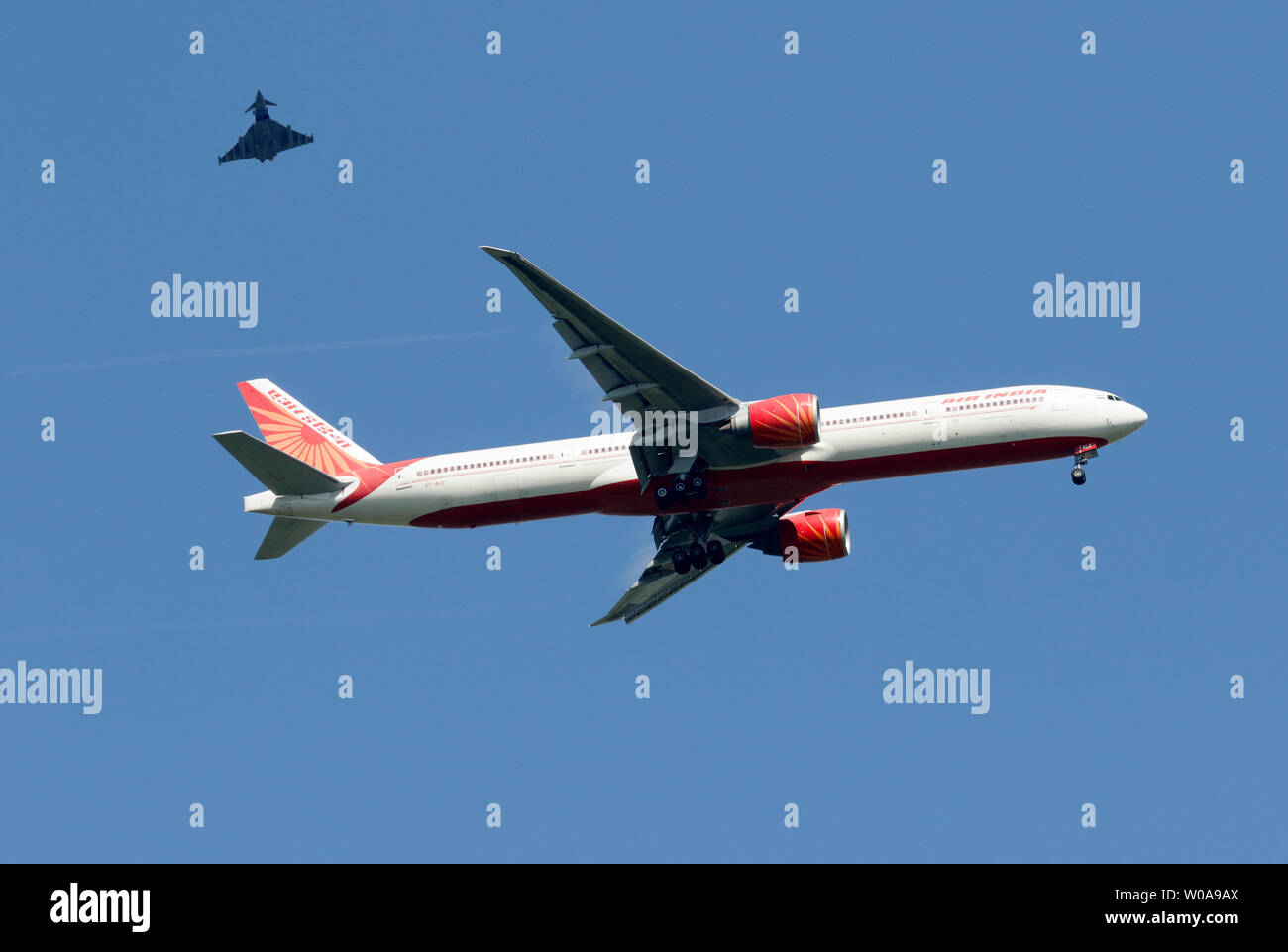 Stansted, UK. . 27th June, 2019. VT-ALK Air India Boeing 777-300 with an RAF Typhoon escort over Sawbridgeworth into Stansted just now. Credit: Nigel Blake/Alamy Live News Stock Photo