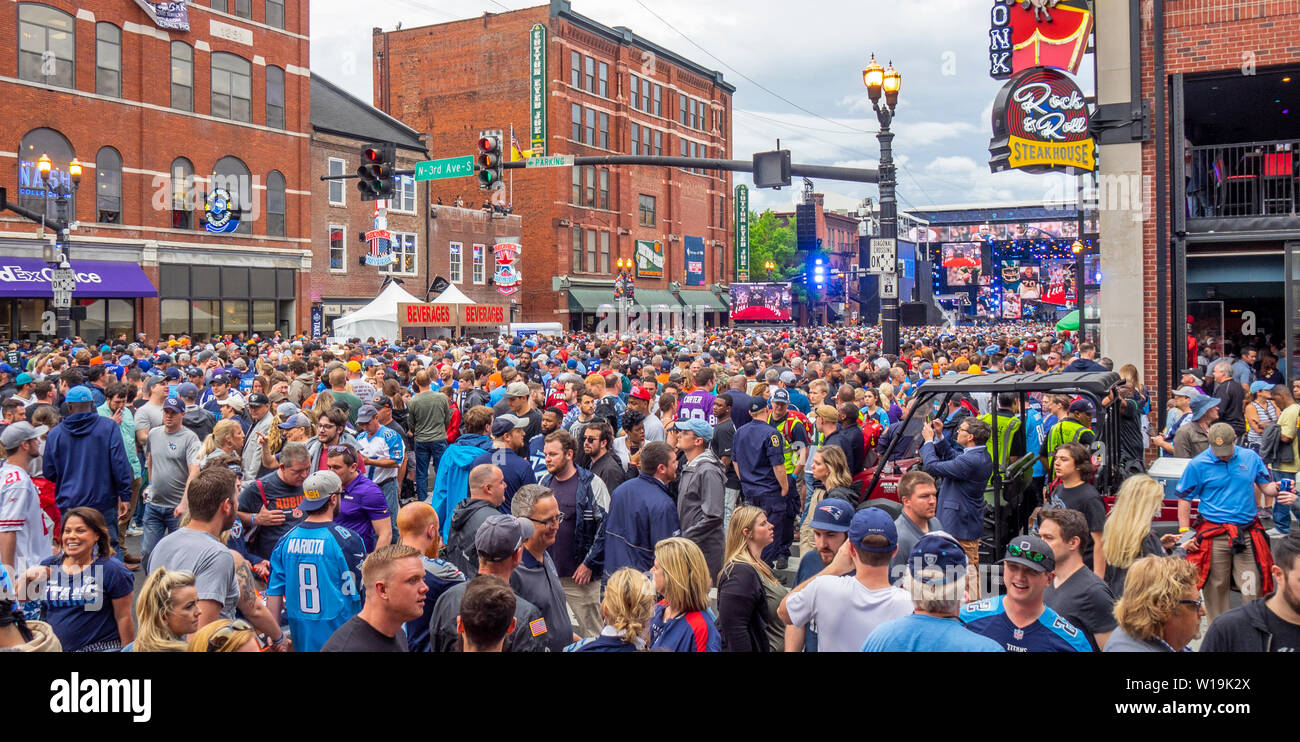 Huge crowd of football fans crowded in Broadway at the NFL Draft 2019, Nashville Tennessee, USA. Stock Photo