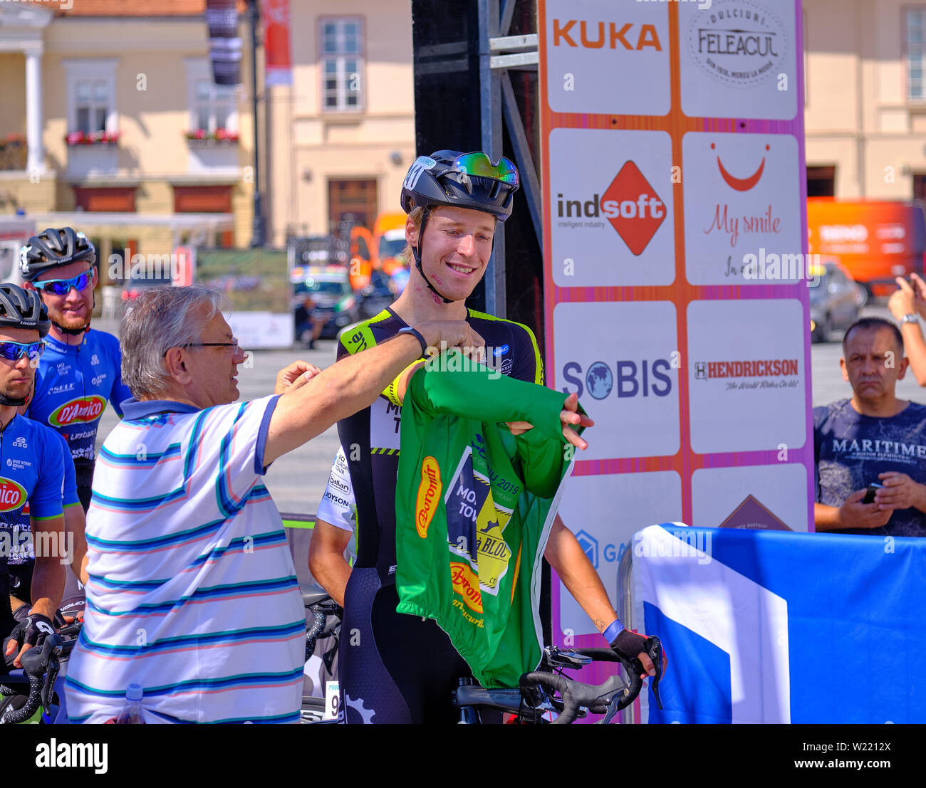 ivar-slik-team-monkey-town-a-bloc-ct-puts-on-the-green-jersey-at-the-start-of-stage-2-of-sibiu-cycling-tour-romania-july-2019-W2212X.jpg