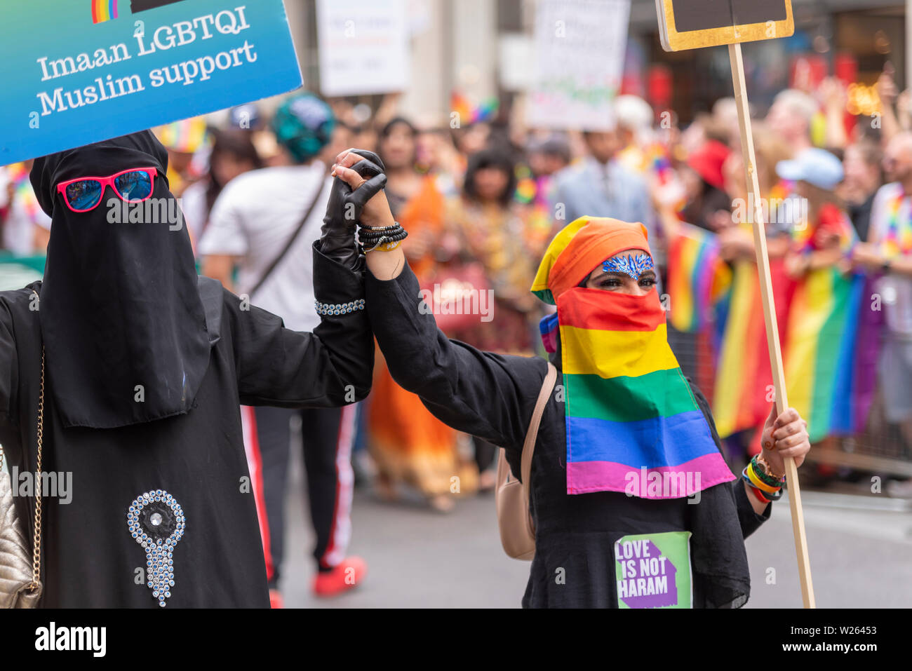 pride-in-london-aims-to-promote-all-aspects-of-the-lgbt-community-in-a-colourful-parade-from-portland-place-to-whitehall-2019-marks-the-50th-anniversary-of-the-modern-gay-rights-movement-and-is-expected-to-be-the-biggest-and-best-yet-muslim-islam-females-with-niqab-niqaab-ruband-hijab-face-veil-rainbow-colours-W26453.jpg